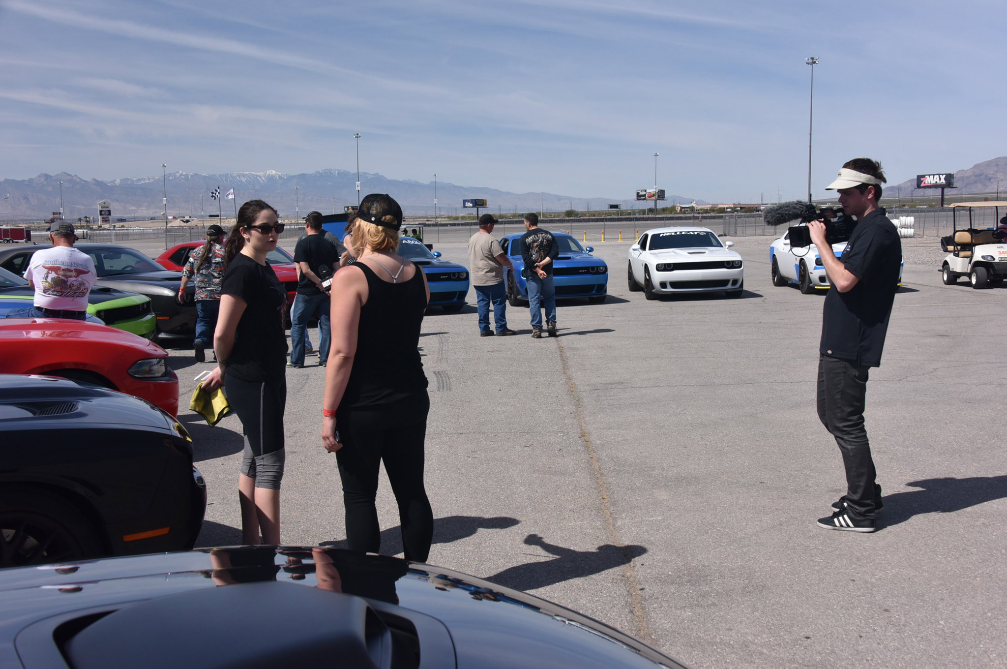 At the driver's meeting, Mopar Muscle videographer Kale Eickhof interviews Miss Mogane Caen, our sole female contestant, and owner of a brand new 2016 Hellcat Challenger.