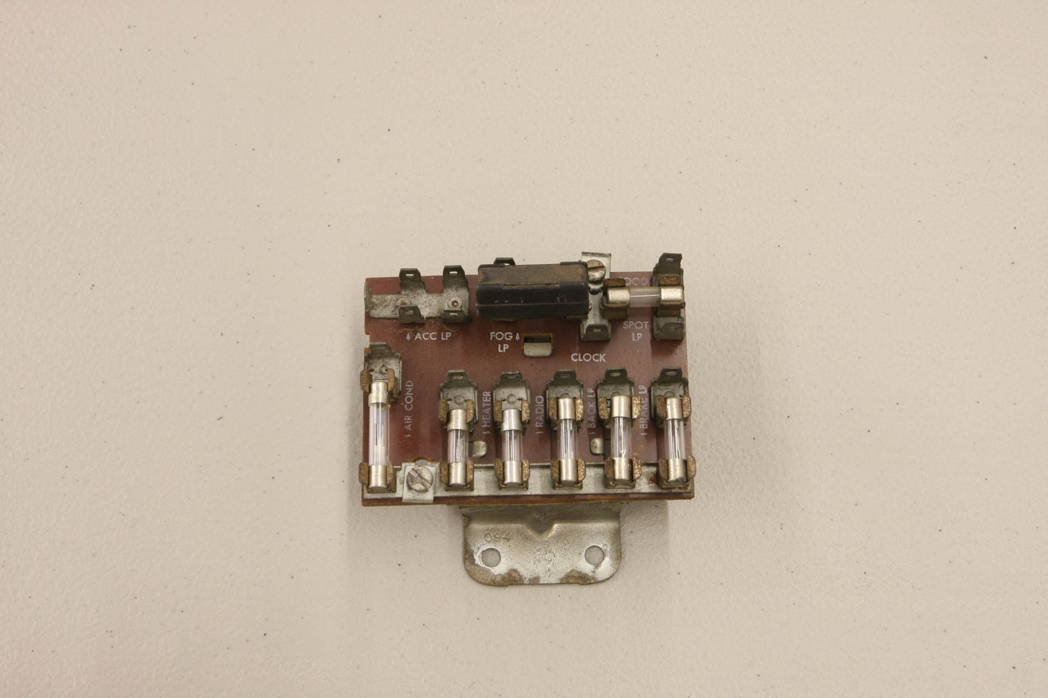 While it may have worked in its day, the original fuse block is inadequate for contemporary demands