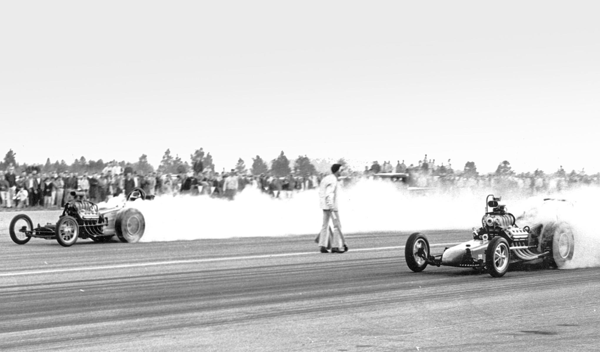 Here's another potentially groundbreaking event. The Thrifty and Kelly cars chose off against each other in the first round of eliminations on April 9, 1961, making this probably the first ever drag race between two nitrous-injected dragsters, if not cars in general. It ended in a marvelously fitting dead heat. Thrifty took Top Eliminator, with a head gasket taking out the Kelly car.