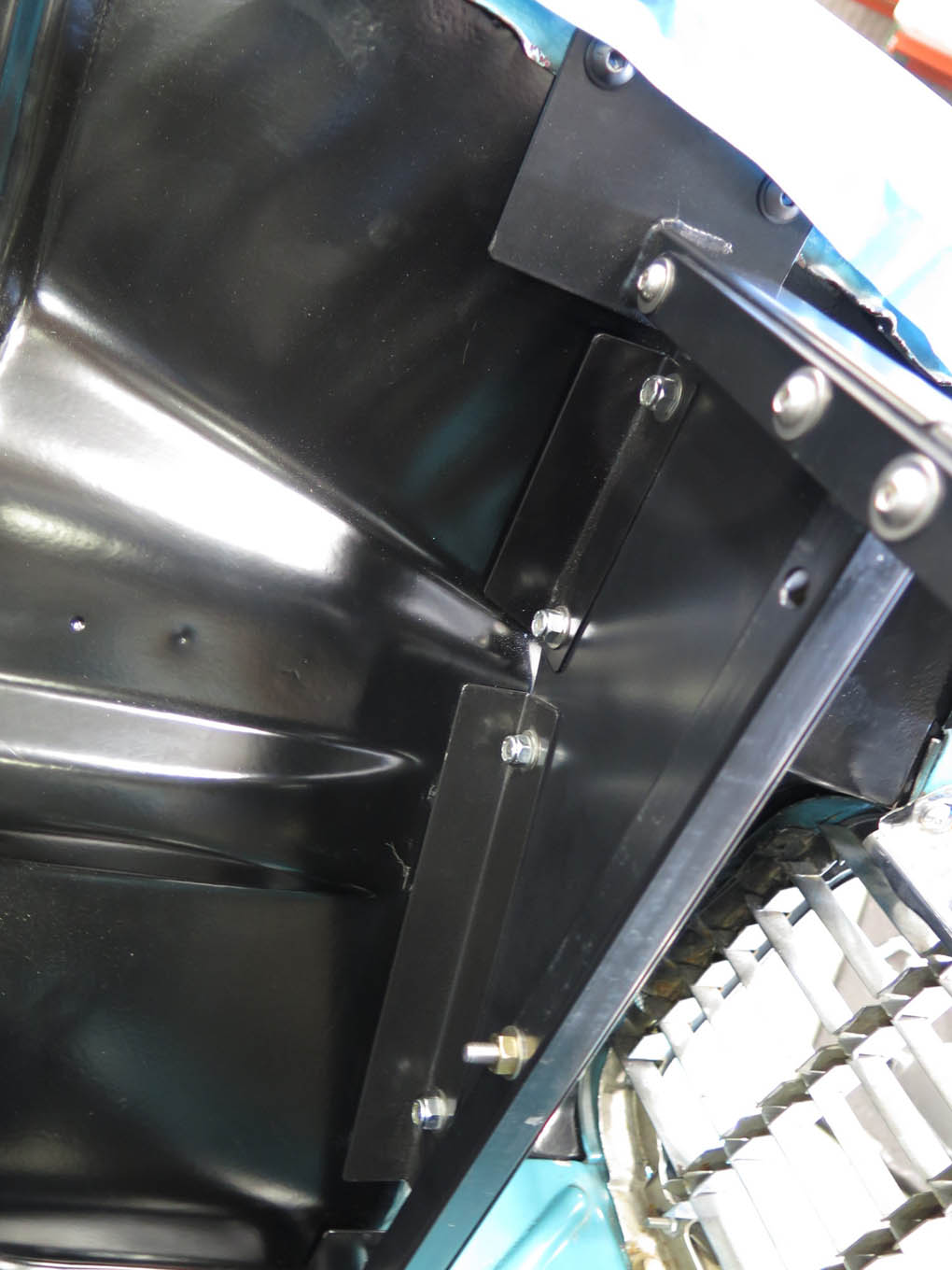 The series of sheetmetal flanges on each side of the core support are not pre-drilled; align inner fender panels as needed (maintaining consistent fender-to-body gaps).
