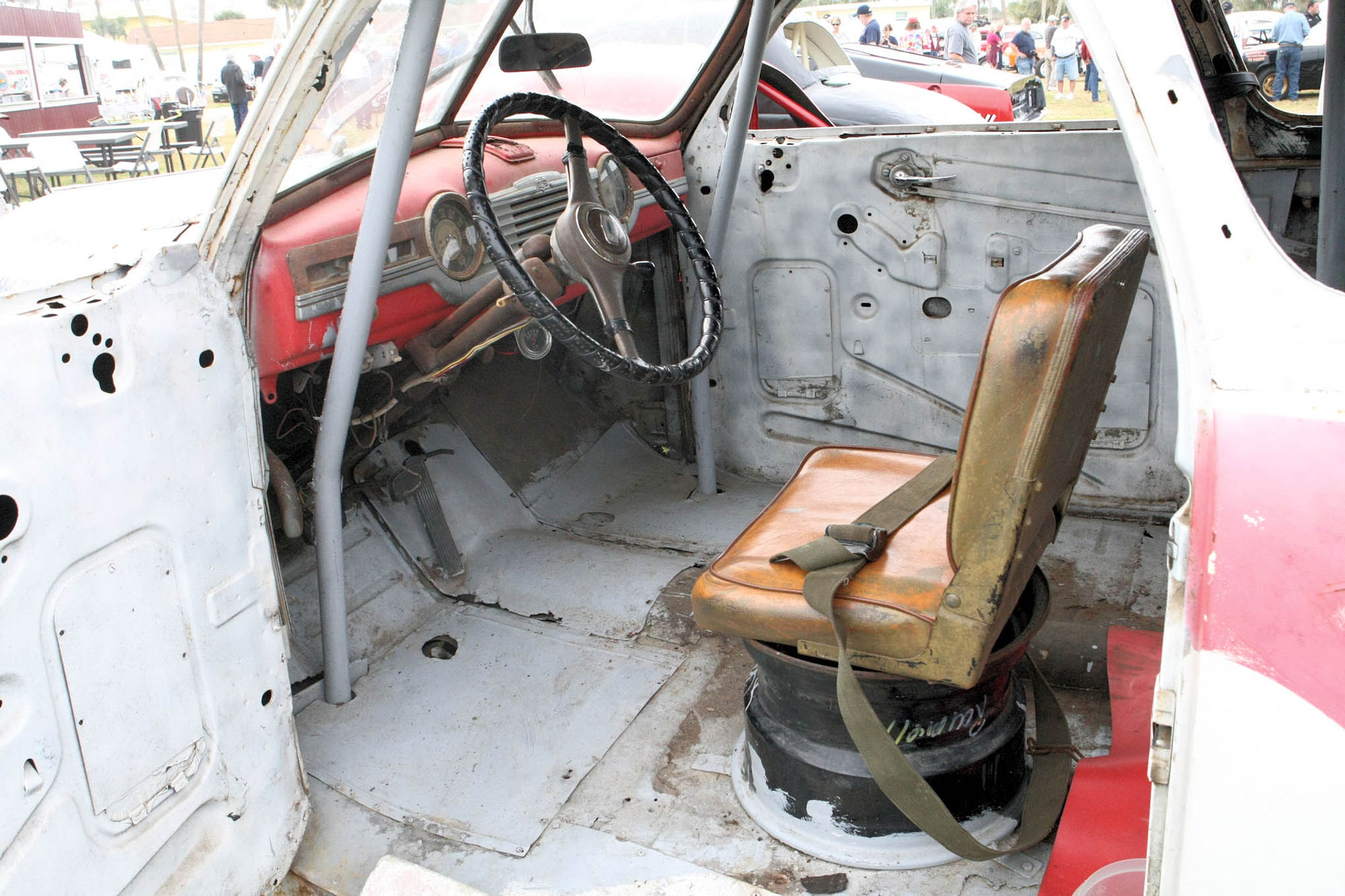 Look how far safety features have come. One can only imagine sitting in this car, let alone racing with it.