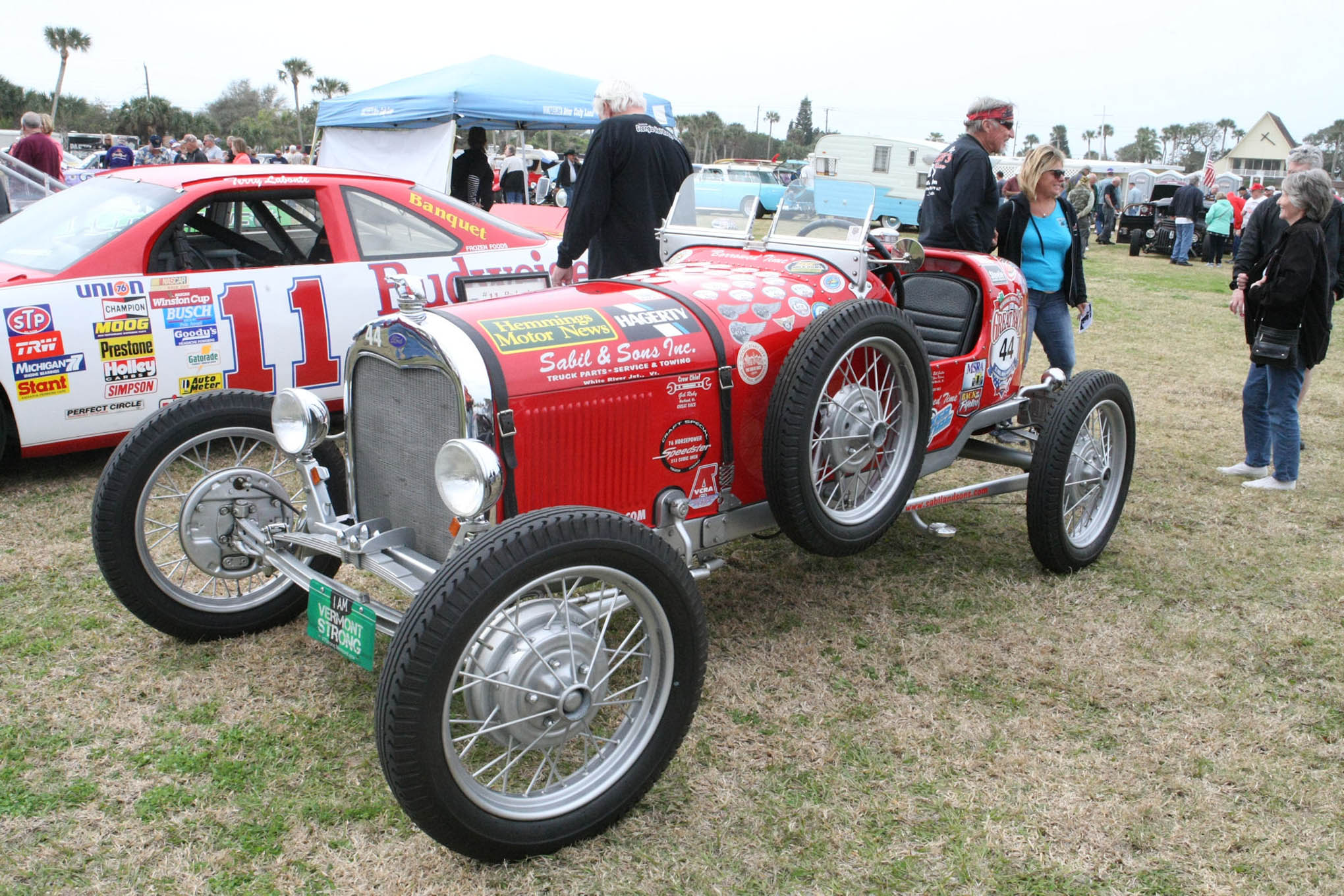 At the back of this old restored open wheel jalopy stands Open Wheel racer and Little 500 winner Bentley Warren sharing a laugh and story with some race fans.