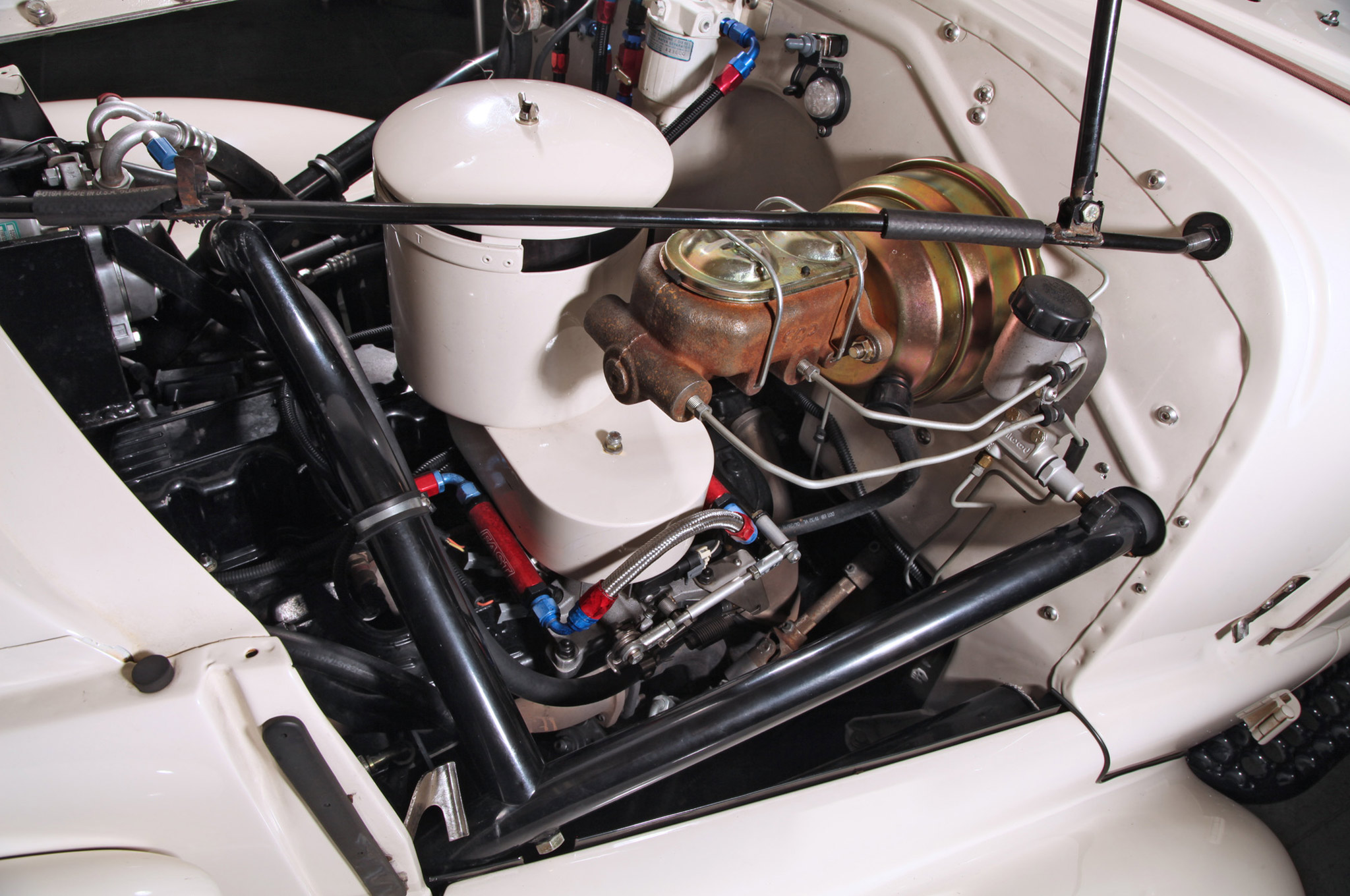All three Chevys run a variation of Chevrolet's venerable 250ci inline-six. A few things like the hefty full cage seen here inspired Bill to go bigger on his—he stroked his with a 292 crank.
