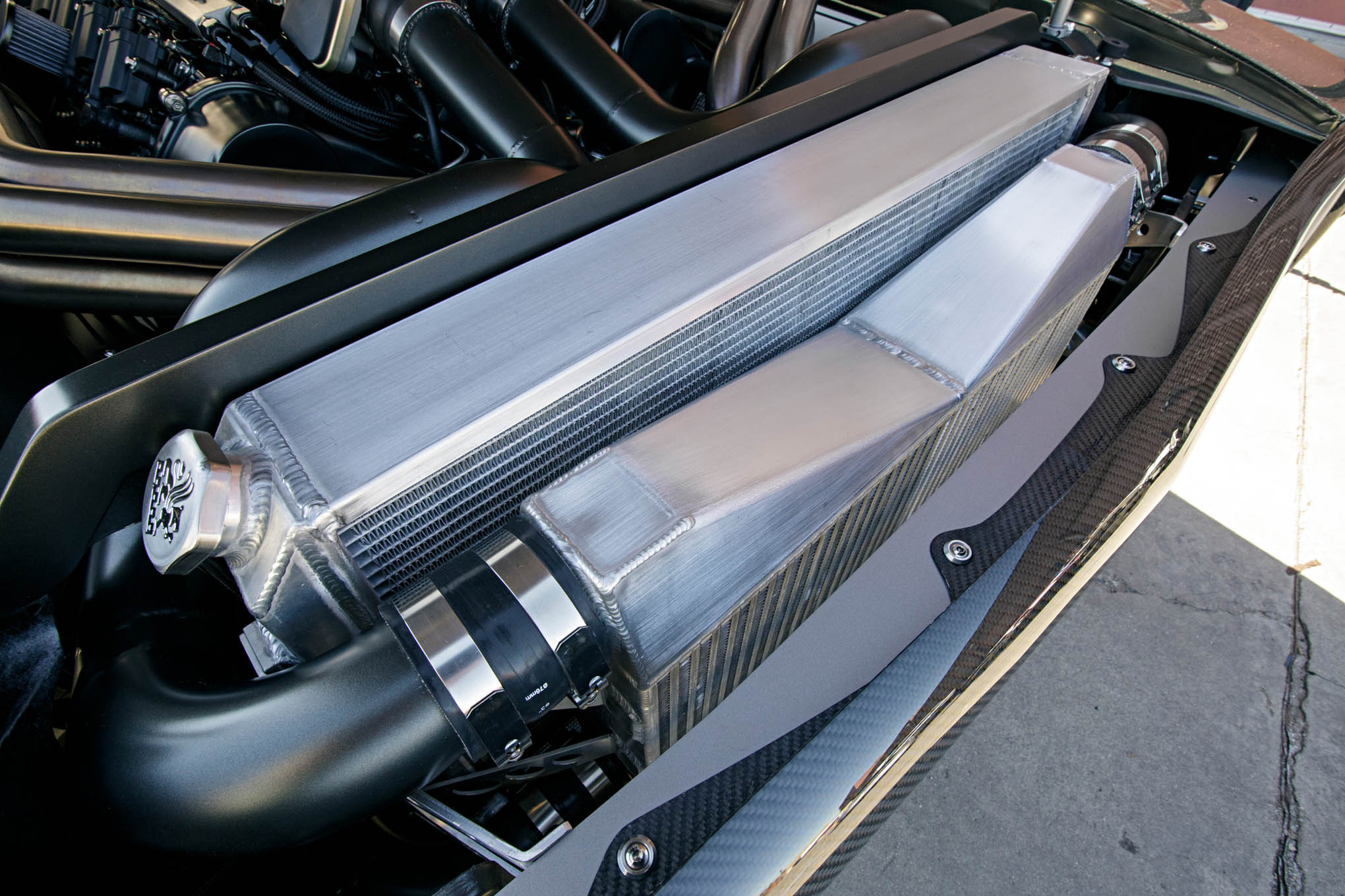 When an engine produces 1,650 hp, it needs some serious cooling. A massive charge cooler and radiator fill the nose of the Charger.