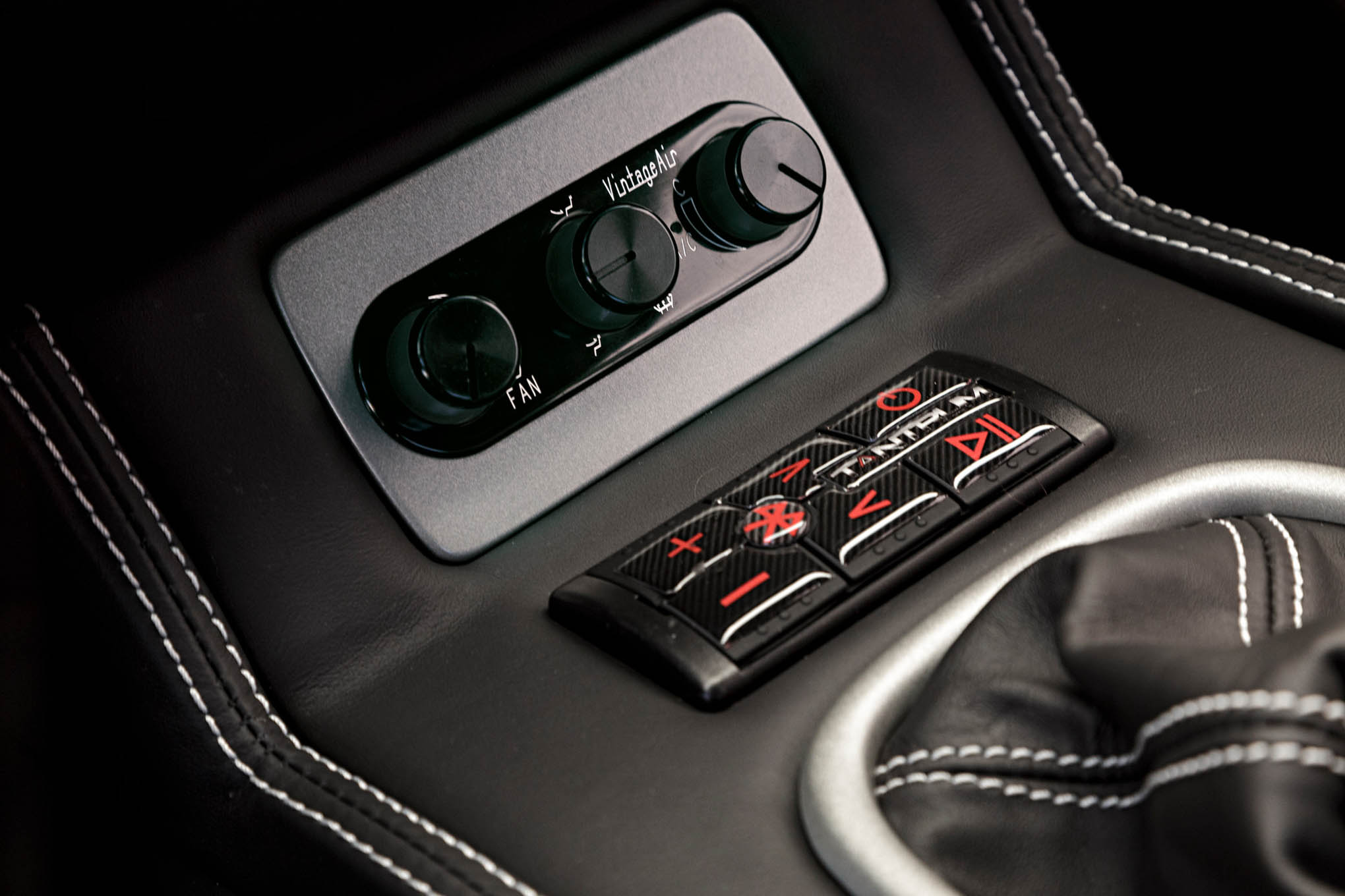 Controls for the Vintage Air A/C and Kicker Bluetooth controller are just forward of the shifter.