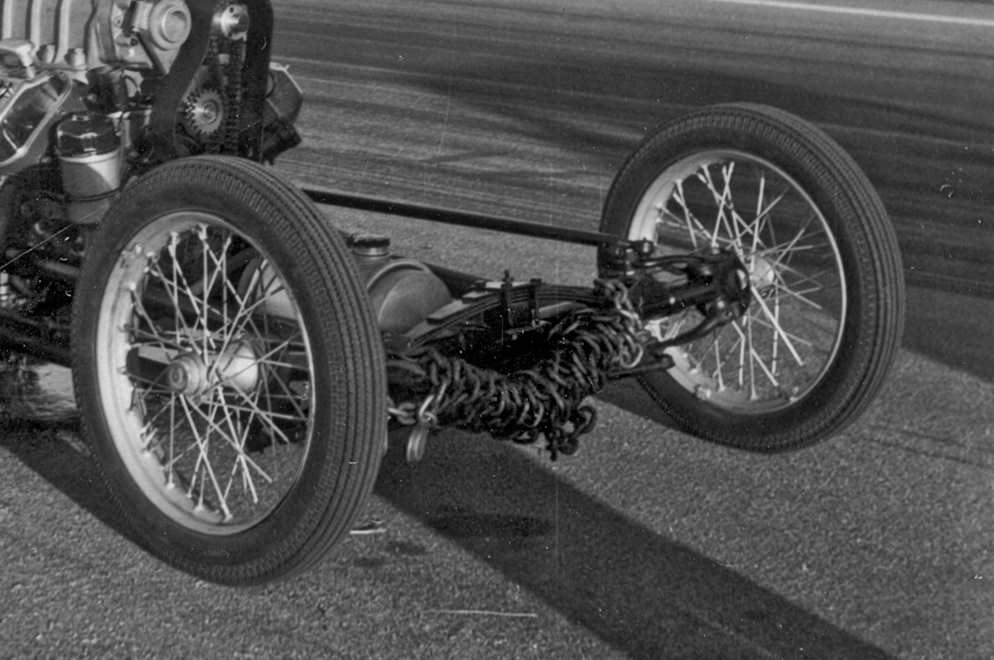Naturally, the shorter wheelbase made the car prone to wheelstand. The team initially wrapped the axle with logger's chain, but later resorted to bolting an entire floor jack to the axle.