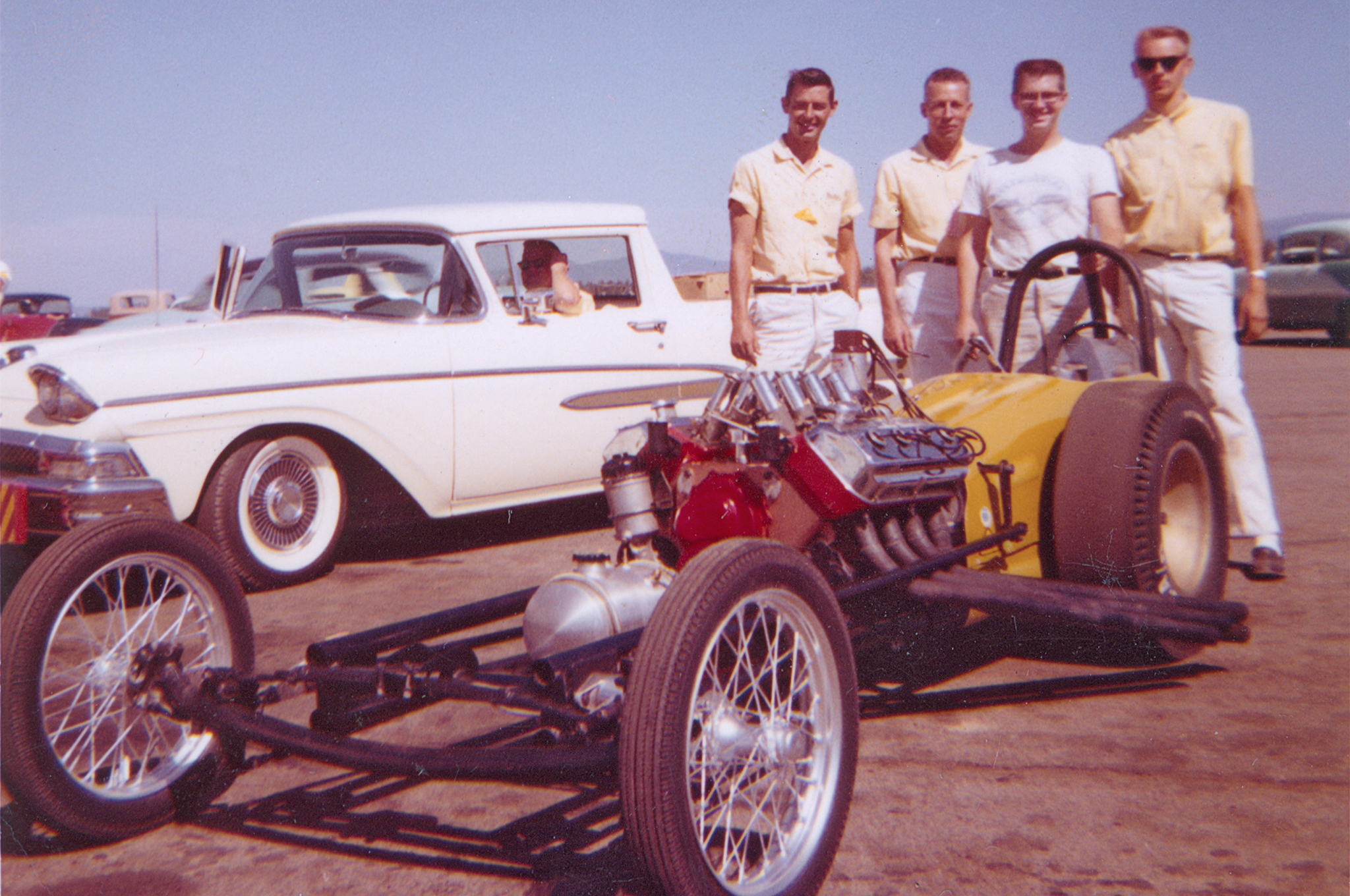 Don Stortroen built the Thrifty dragster as a conventionally long car by 1959 standards. Initially, it ran an injected 392, but got the supercharger not long after this Deer Park image. From left to right, that's Warsinski in the Ranchero, crewmember and first Thrifty driver Bob Miller, Thrifty Auto Supply owner Hank Clay, engine builder Dick Flynn, and driver Don Stortroen.