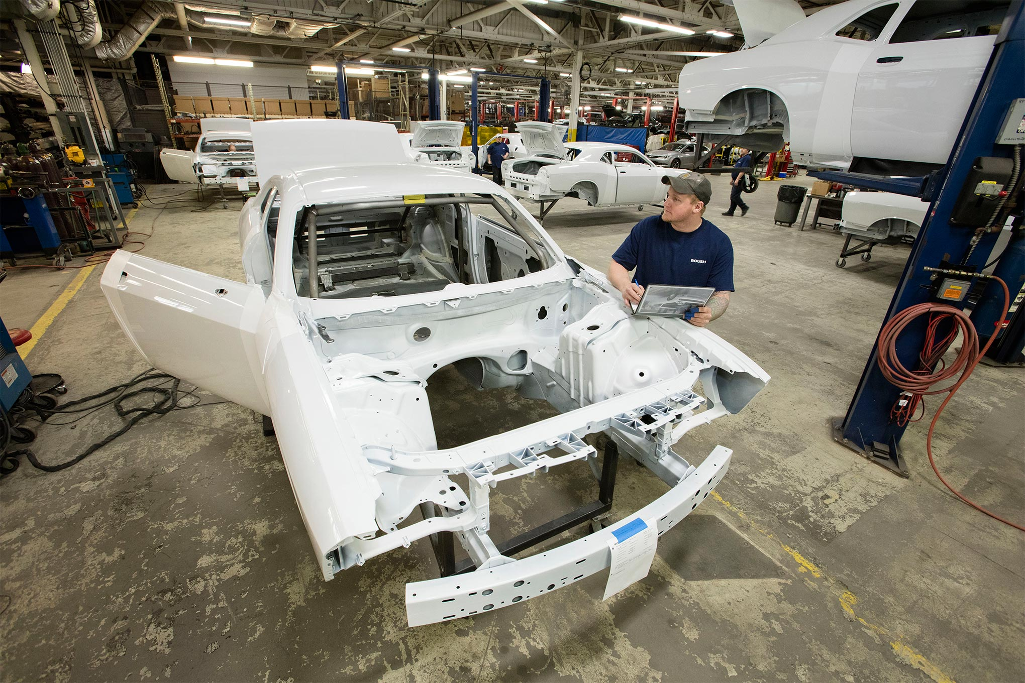 """The Challenger Drag Pak's bodyshell comes from the Brampton Assembly plant painted """"Bright White."""" They get pulled off the line before the sound deadening gets applied and VIN sequencing begins. Usually five to eight bodies a week show up at the Roush Facility in Michigan, which builds the finished Drag Pak cars."""