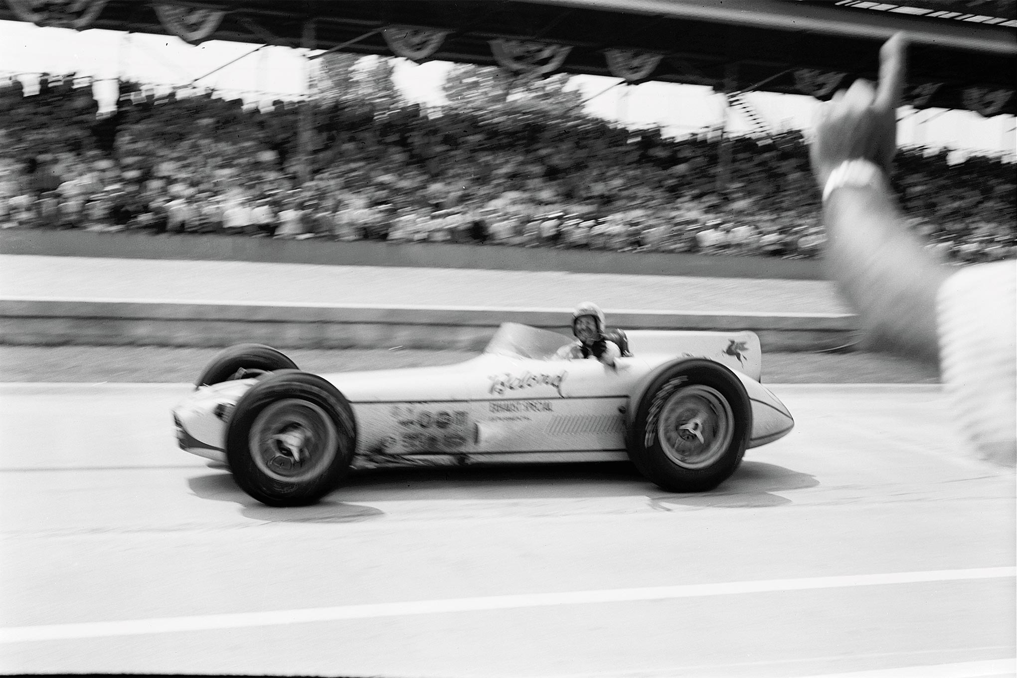 """Prior to the race, Sam Hanks vowed to retire from champ cars after his 12th Indy 500 attempt and promptly did. Car owner George Salih, by day the shop foreman for Meyer-Drake, built the revolutionary Belond Exhaust Special by night in his home garage. His winning formula combined the field's lightest (1,650 pounds, dry) and shortest (35 inches at headrest) package with an Offy """"laid over"""" to the inside, within 18 degrees of horizontal—putting its crankshaft 5 full inches to the left of center."""
