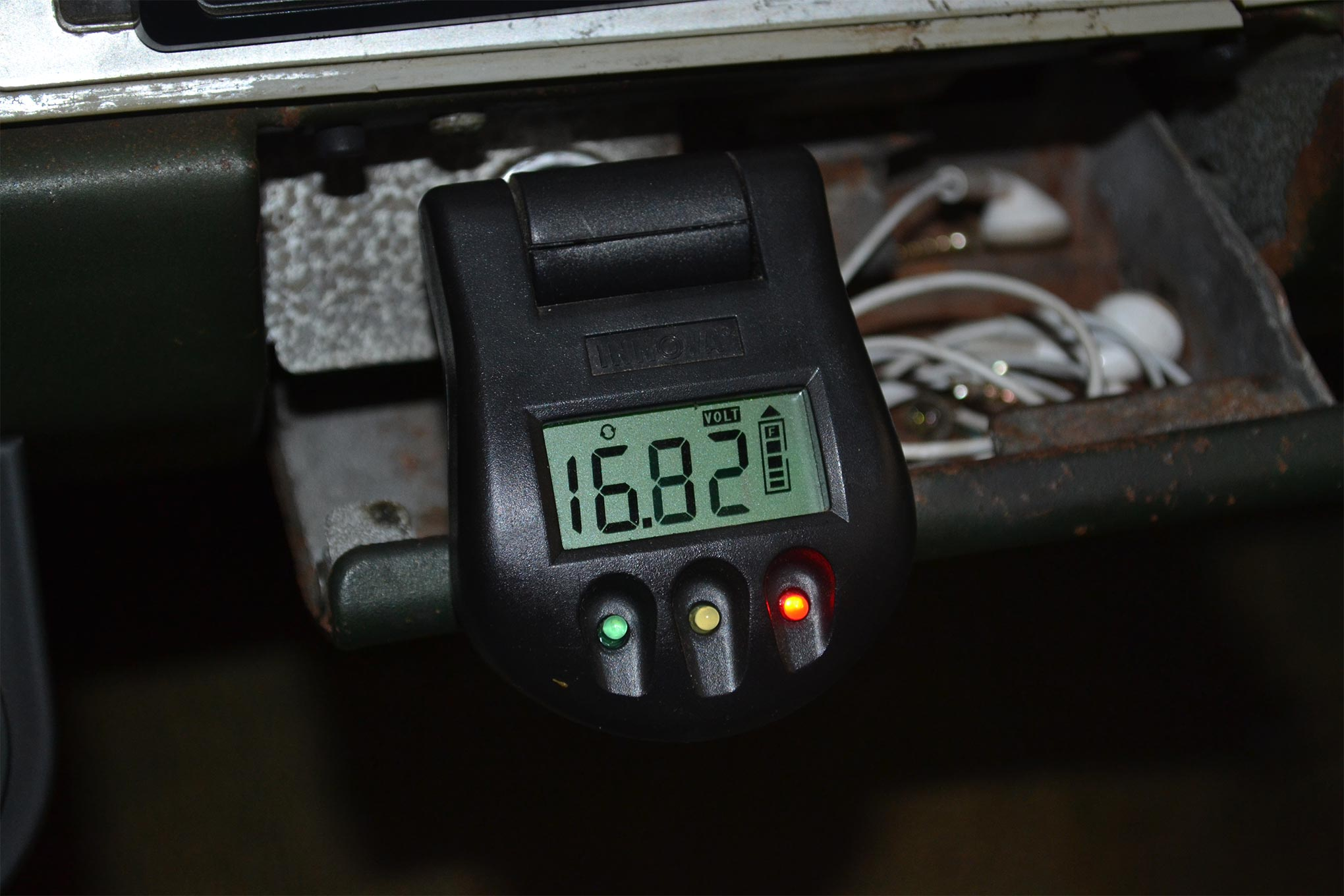 After hooking up this handy Innova voltage tester to our cigarette lighter, our eyes got wide. When revved up, the alternator would start charging at nearly 17 volts, which is more than enough to blow up a battery.