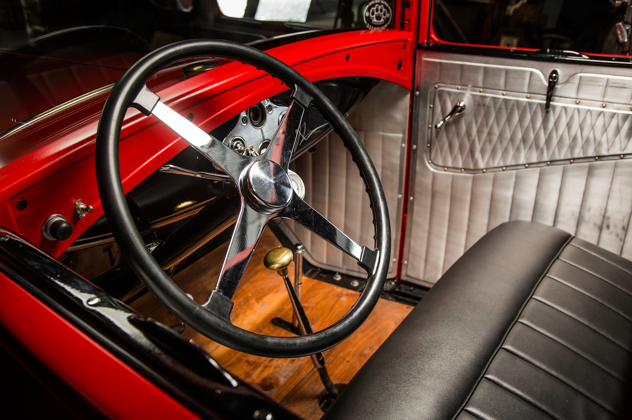 Joe puts miles on his Model A, so the interior has to be a comfortable place. He recovered the original seat in vinyl and mounted a Bell-style four-spoke steering wheel to the stock column. Those alloy door panels are from Bear Metal Kustoms.