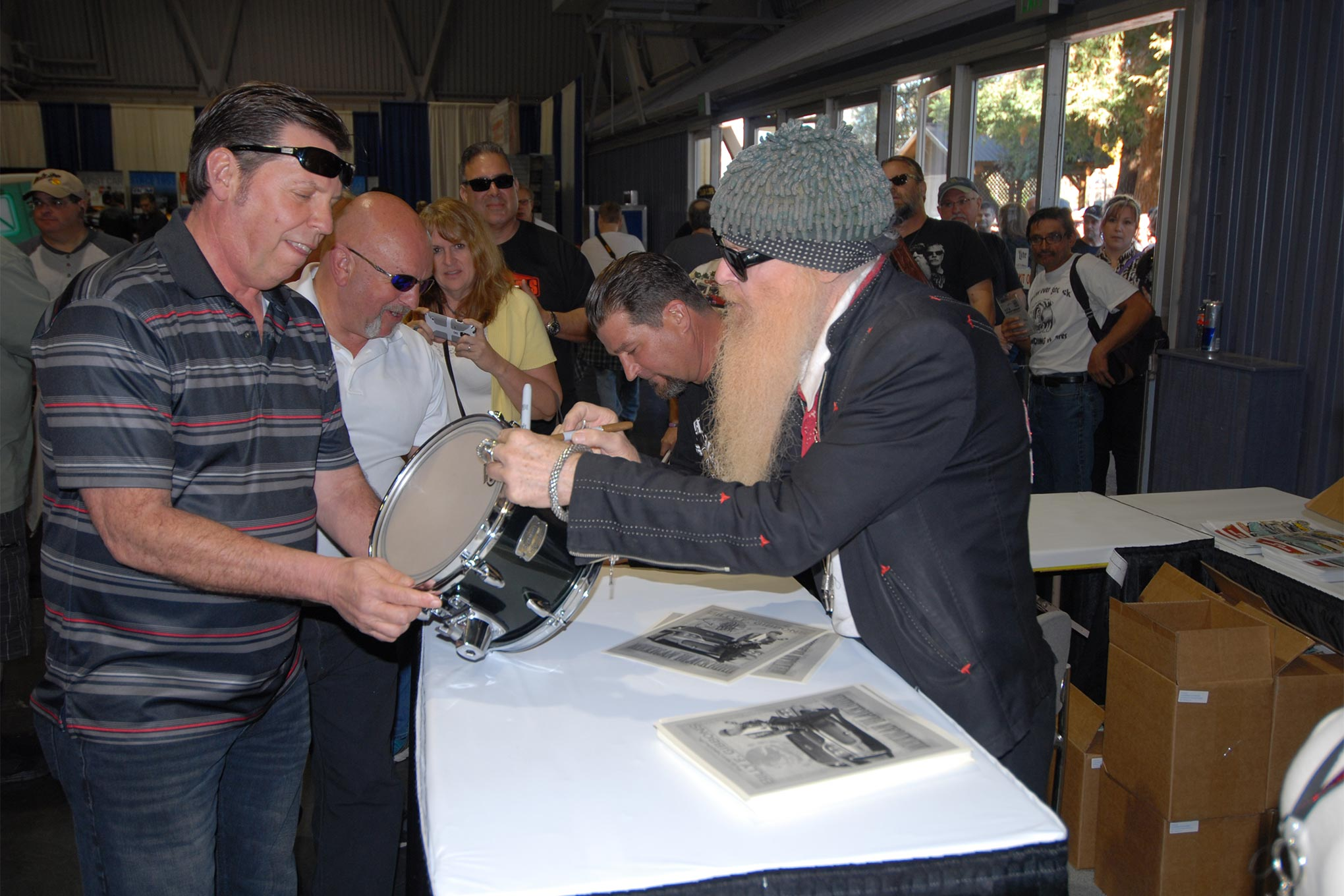 Star Power: The line of autograph seekers extending outside and partway around the main building on Saturday suggested that celebrities Billy Gibbons and Jimmy Shine had something to do with attracting the biggest single-day crowd in recent history.