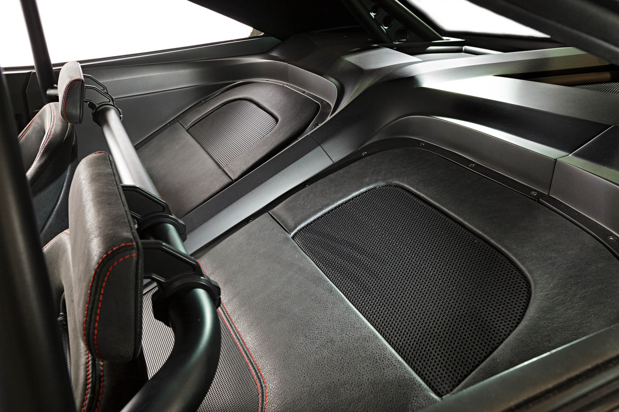 Yes, the rear seats have been eliminated, but check out how the sheetmetal has been created to take this from a dead space to something entertaining to view and how well everything relates and is integrated to everything else around it.