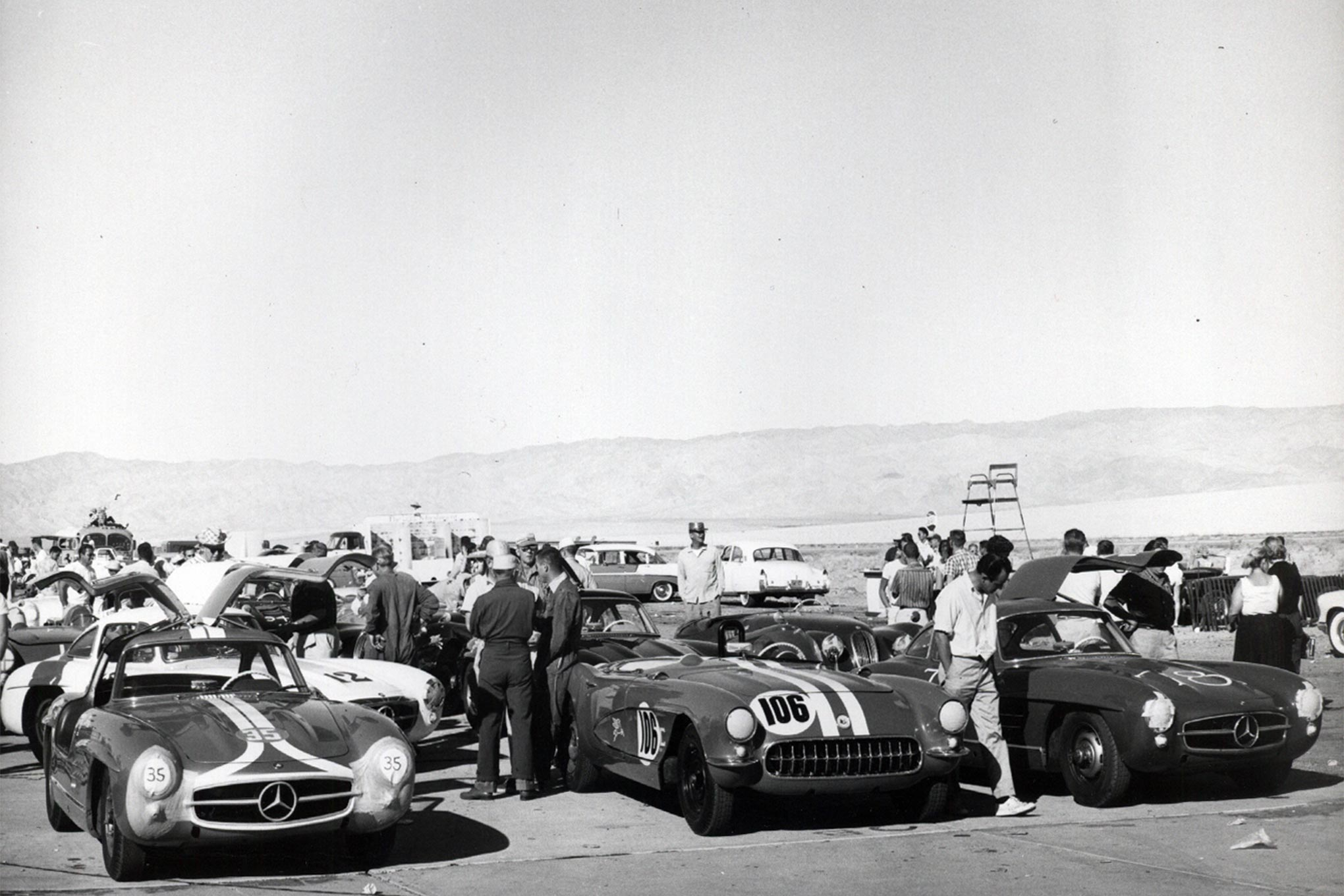"Following their Production-class race, HOT ROD's hot rodders were known to reappear in the main event, challenging state-of-the-art European exoticars. ""America's sports car"" is surrounded by a trio of Mercedes-Benz gull-wing coupes. Having tested one at Motor Trend, D'Olivo described the 300 SL as ""practically a race car, right off the showroom floor."""