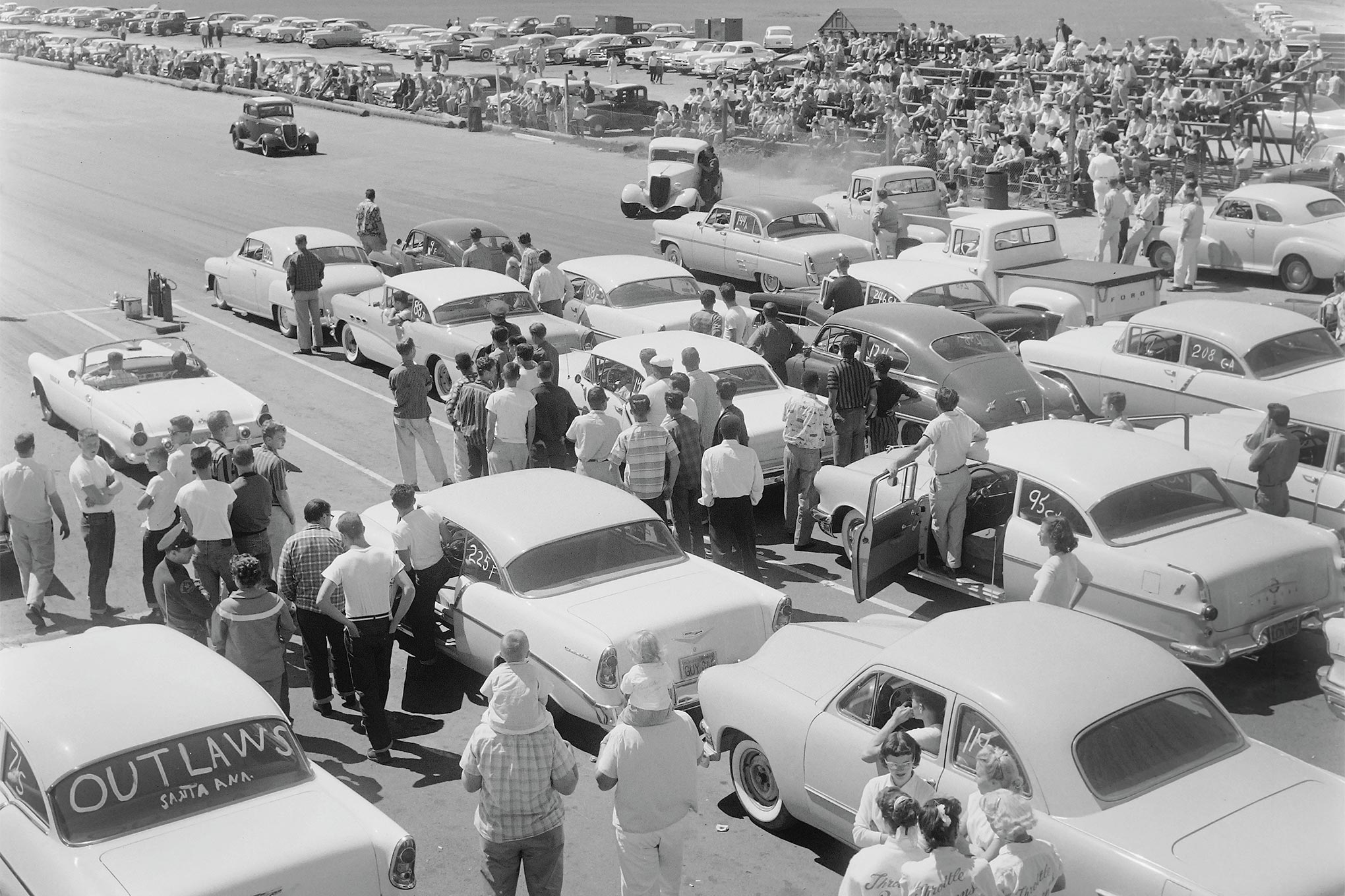 Here's another view of Santa Ana that same day, shot from the giant scaffolding erected for Life's photographer. In continuous operation from 1950 to mid-1959, the future site of Orange County's John Wayne Airport was the first commercial facility to host weekly drags.