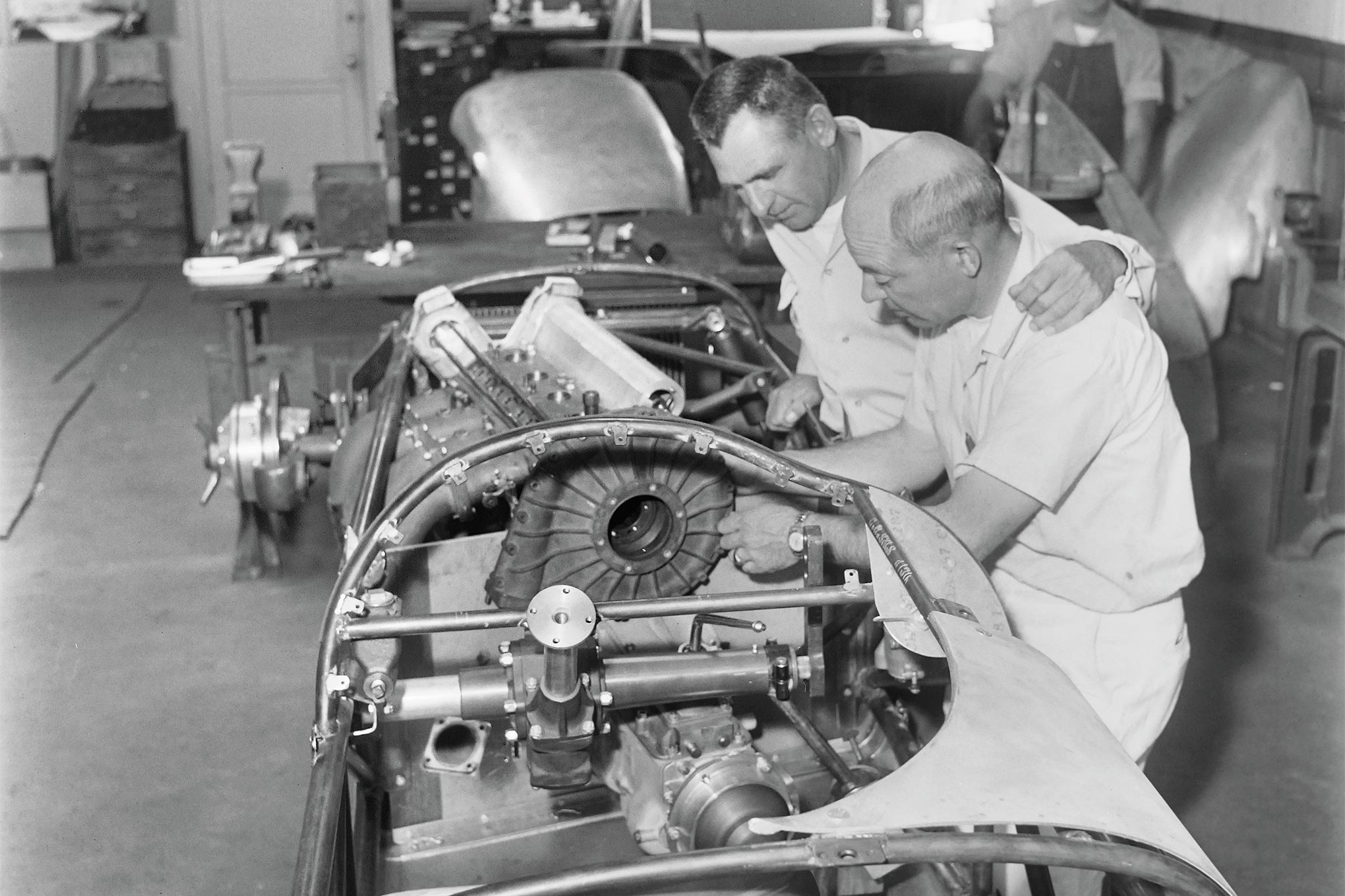 The Indy 500's only supercharged Offy was angled into this skinny package by chassis builder Lujie Lesovsky (foreground). The offset powertrain and seating position theoretically increased traction through IMS's turns, but Rodger Ward finished 30th for car-owner Roger Wolcott. (See June and Aug. '57 HRM for Indy 500 preview and coverage, respectively.)