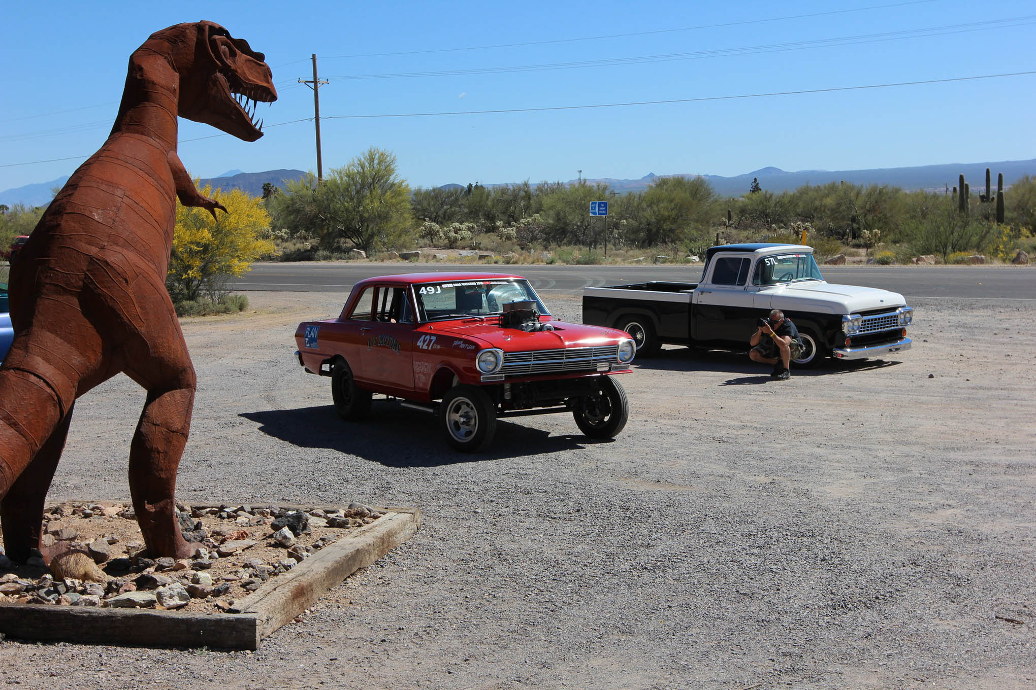Dirt roads and dinosaurs are what makes up the majority of Day 2, checkpoint two. Also a bunch of cool muscle cars.