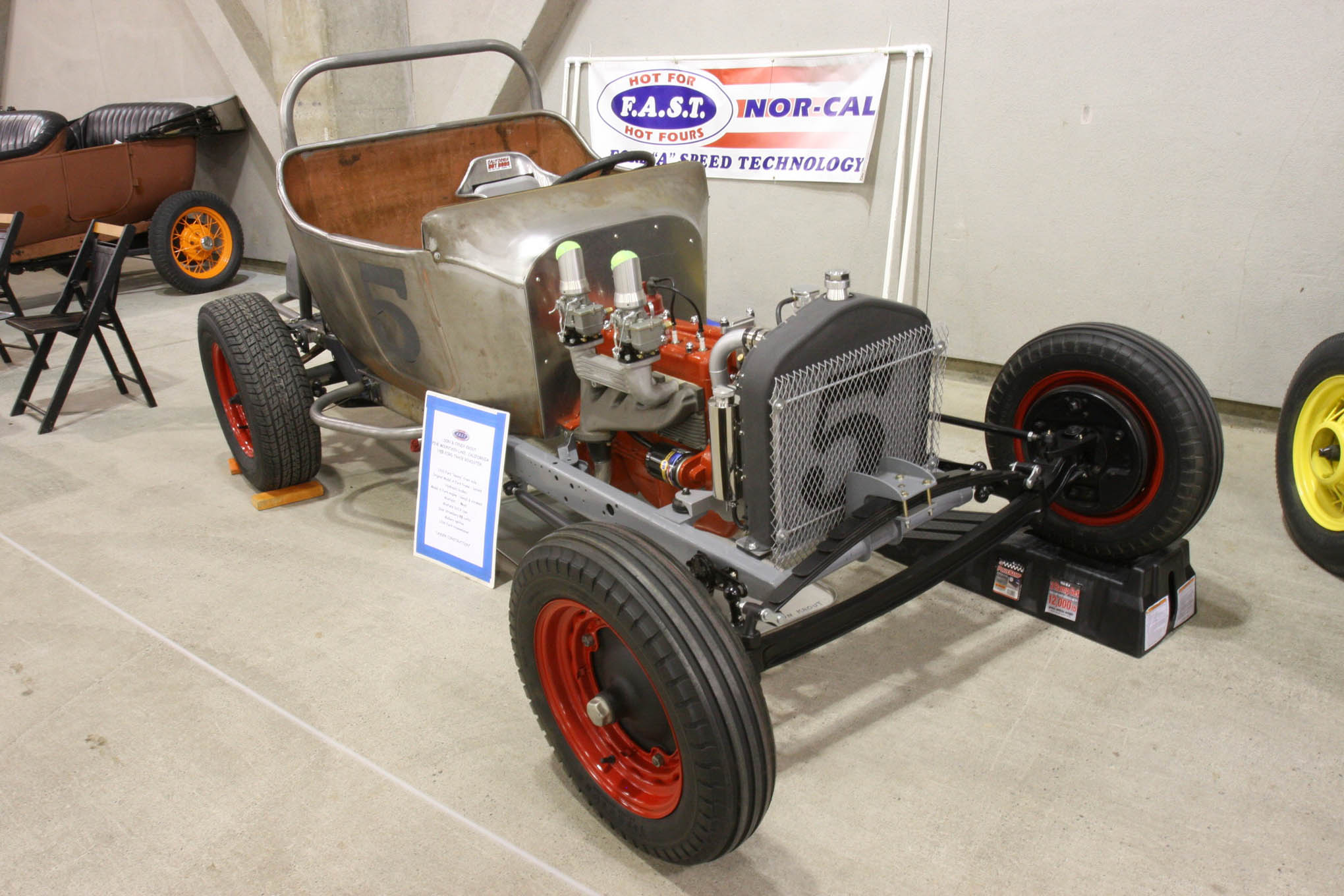 Compare the 1915 center door Model T to this 1915 Ford track roadster owned by Don and Cyndy Krout. The original Model A banger engine is bored and stroked and features a Winfield head and cam, along with a pair of Stromberg 48 carbs.