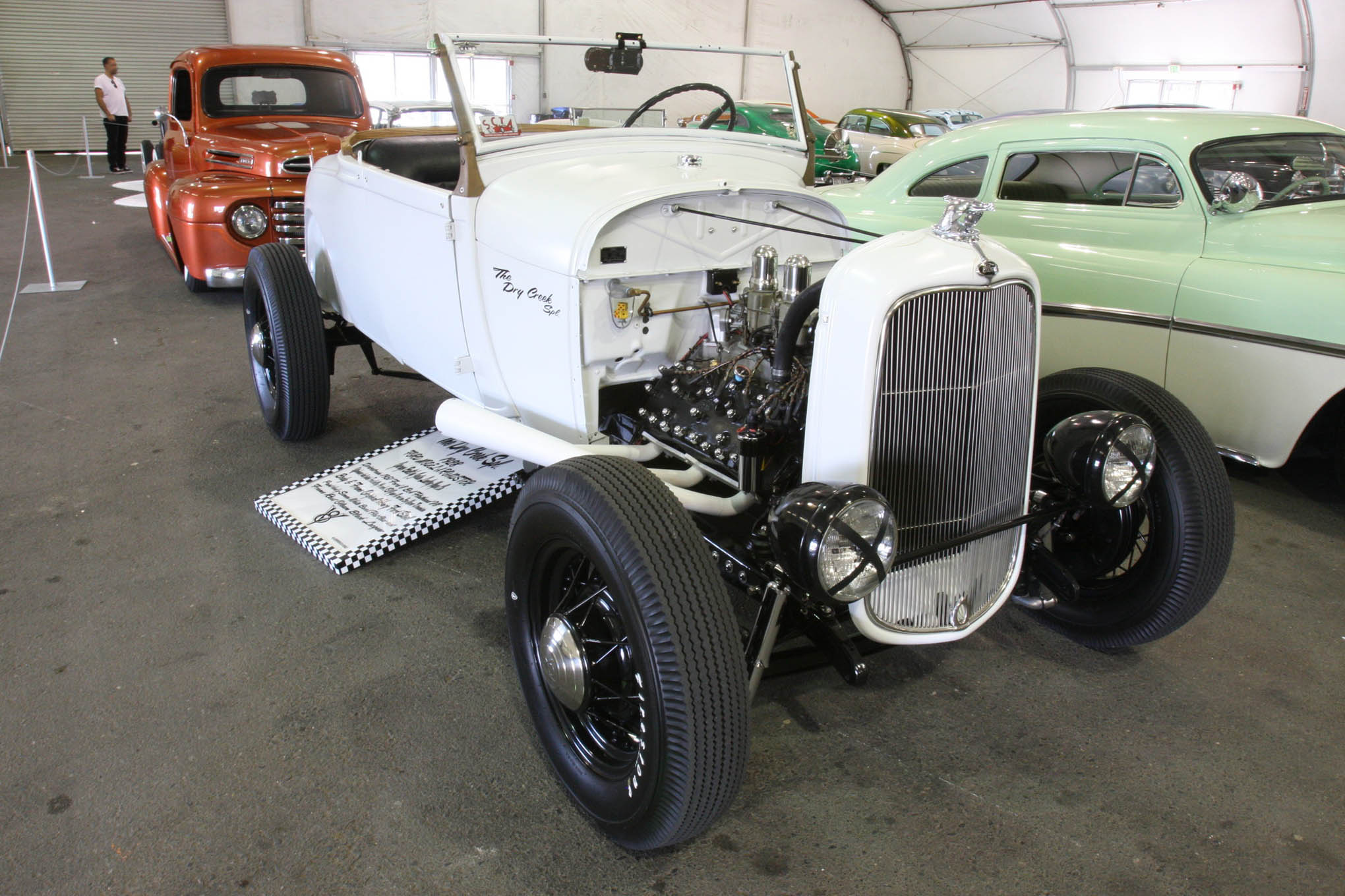 """The Suede Pavilion was a playground for retro hot rods like the """"Dry Creek Special."""" An original 1928 Ford steel body and frame—plus a 1951 Flathead engine, wire wheels, skinny piecrust rubber, and dedication to tradition are all part of the appeal."""