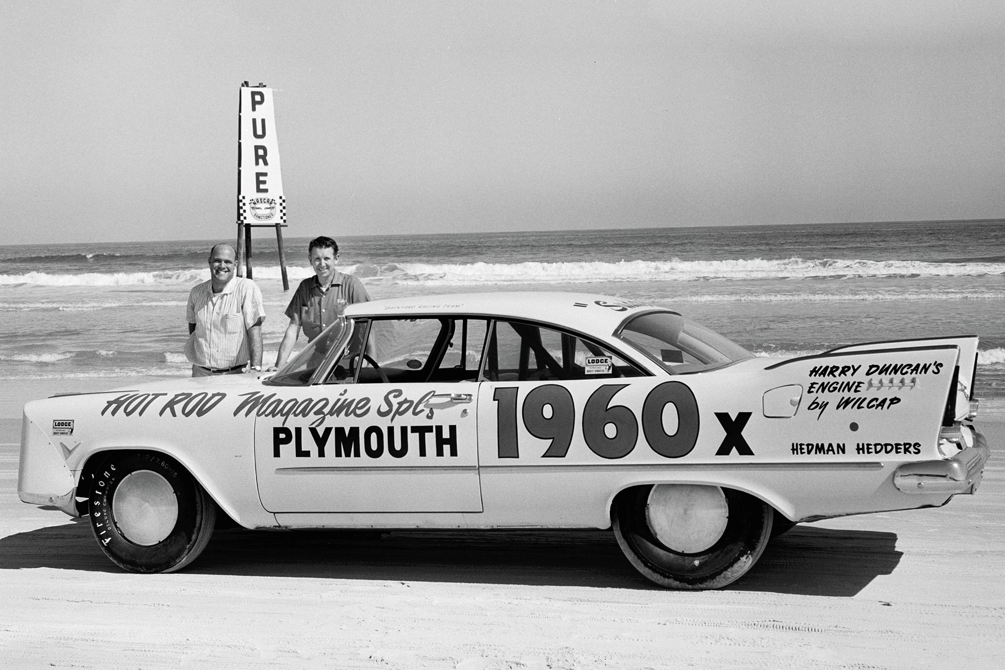 """Less than three weeks after Plymouth's belated delivery of a '57 Savoy, HRM Technical Editor Ray Brock (left) and Editor Wally Parks set a Daytona record for stock-bodied cars, averaging 159.893 mph. Willie Sutton formed the aluminum headlight covers. """"Now, we want to go 180 at Bonneville,"""" Parks wrote (Sept. '57 HRM, """"180 Ain't Easy!"""")."""