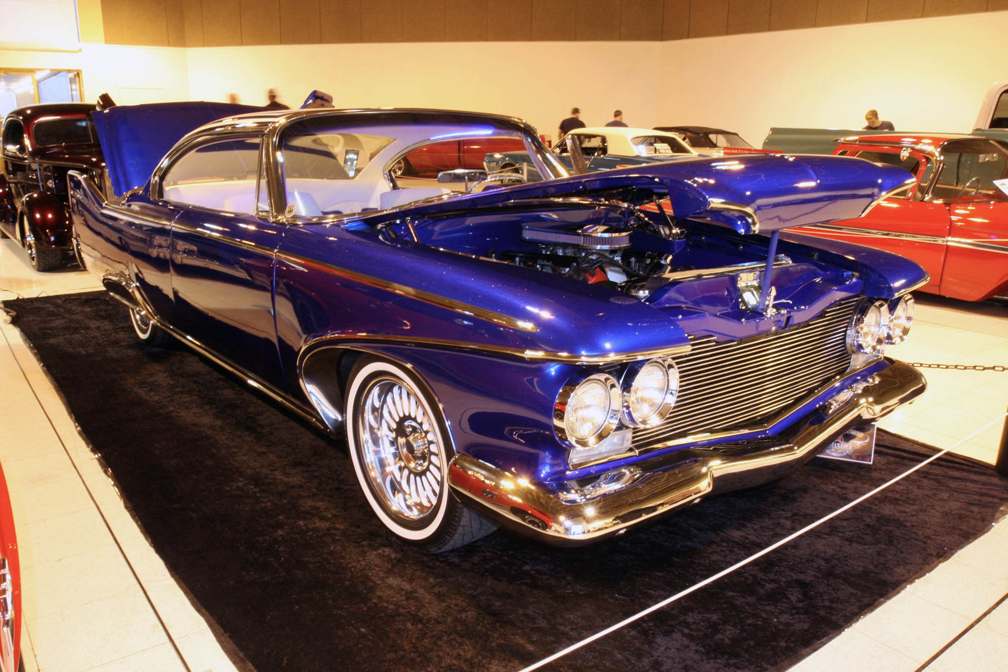 Scott Truss' 1960 Plymouth Fury is a muscle car in custom clothing. The body mods, interior, and paint are to car show level, but the 572ci stroker Hemi with Holley fuel injection under the hood was hot-rodded to make 700 hp. A 4L60E and Dana 60 back up the Hemi.