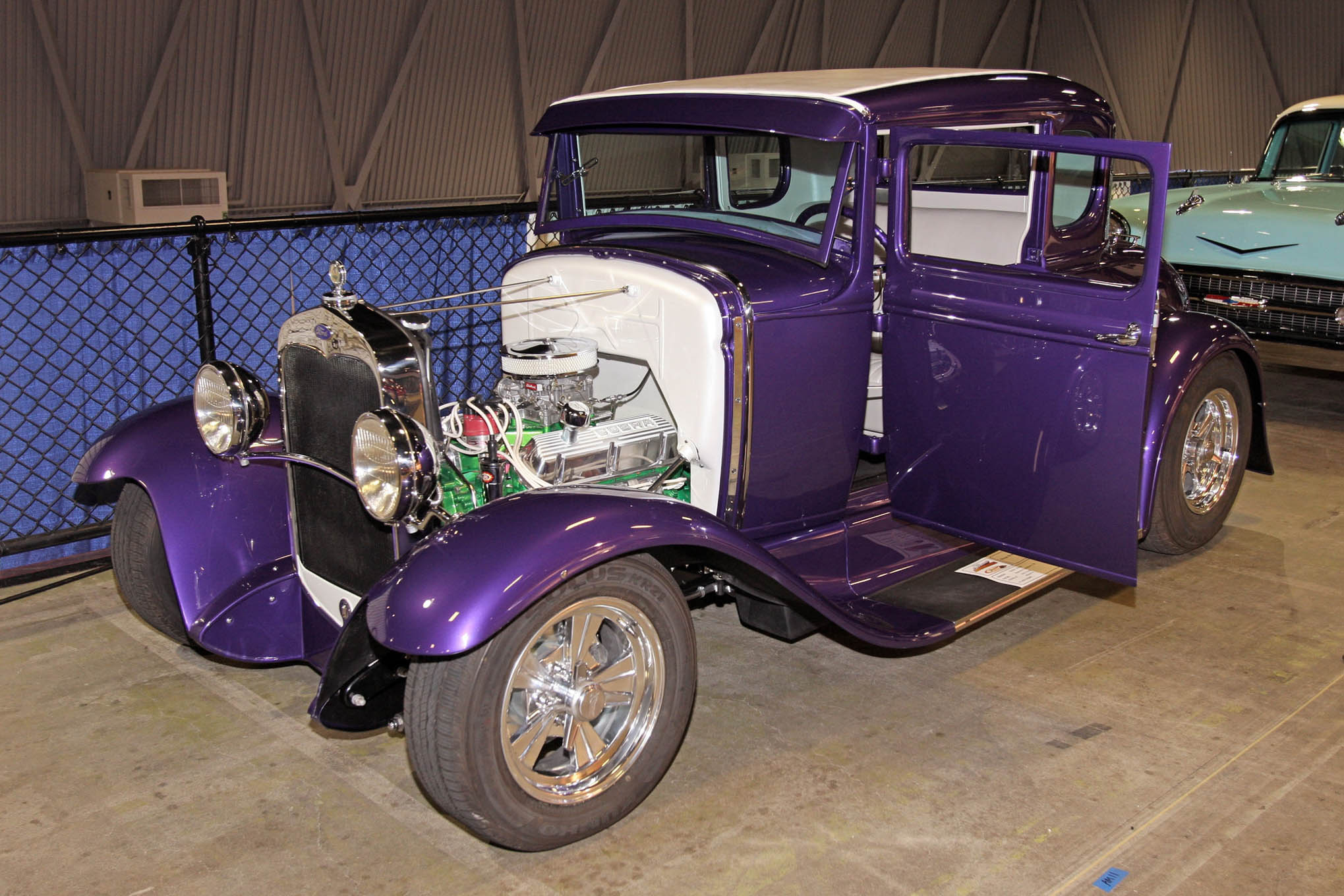 After that violet sheetmetal, green engine and driveline, and bright white firewall, roof insert, and tuck 'n' roll interior, our favorite thing about Greg Shilin's 1931 Ford Model A coupe by Pagano Rod & Custom is the fact that it is actually Ford-powered.