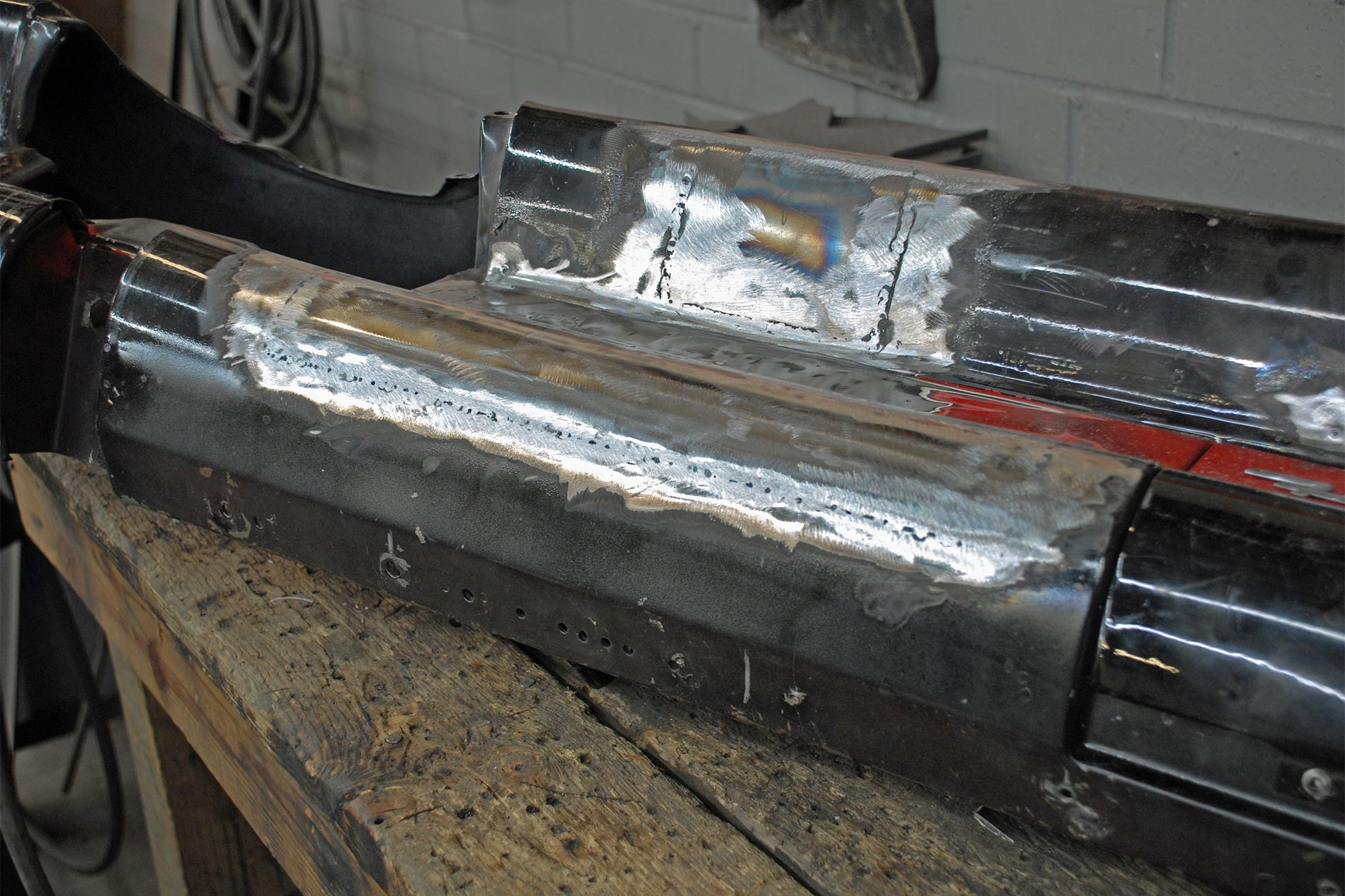 After the welding is complete some careful work with the grinder dresses the welds in preparation for final bodywork. The entire dash will be bead blasted prior to painting.