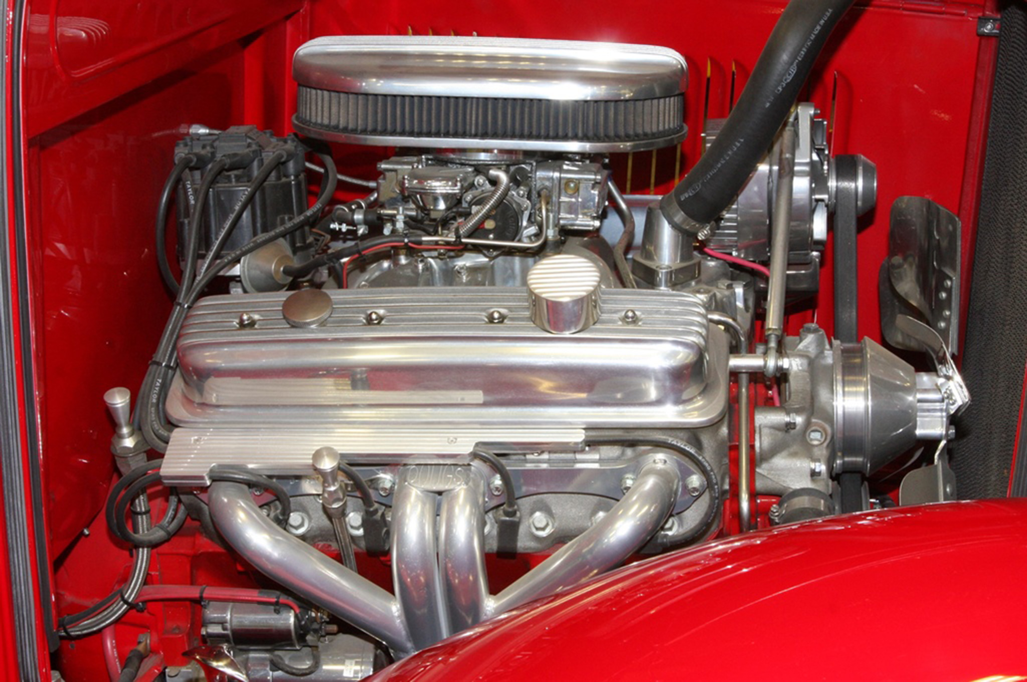 A four-barrel carbureted Chevy 350 with a finned oval air cleaner, finned valve covers, and shorty headers give a '60s look to Gary's Deuce. A TH350 transmission backs up the small-block.