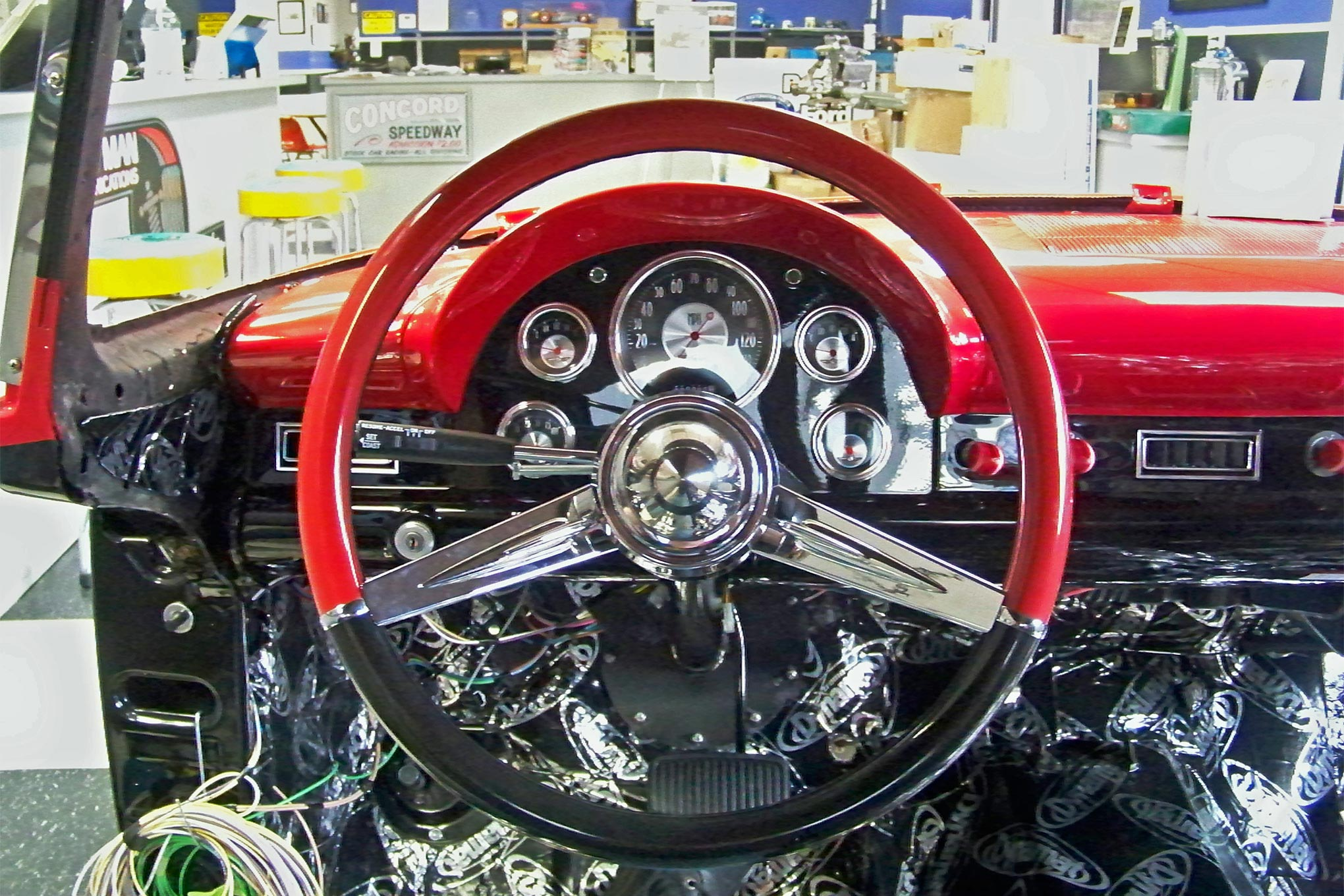 The dropped-spoke design of the CON2R steering wheel provides a clear view of the Classic Instruments. Thinking of details like this during the build makes driving the car a real pleasure.
