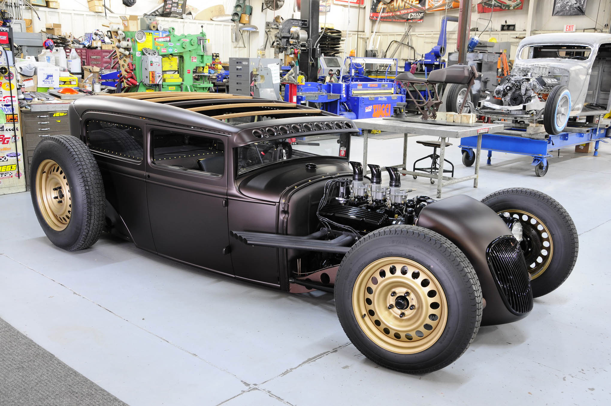 Recently completed, this 1931 Ford sedan features endless design elements starting with its hammered-to-the-ground stance, complemented by a perfect chop and channel. The Tucci-designed chassis is packed with small-block V-8 power while the body is coated in PPG flat brown.