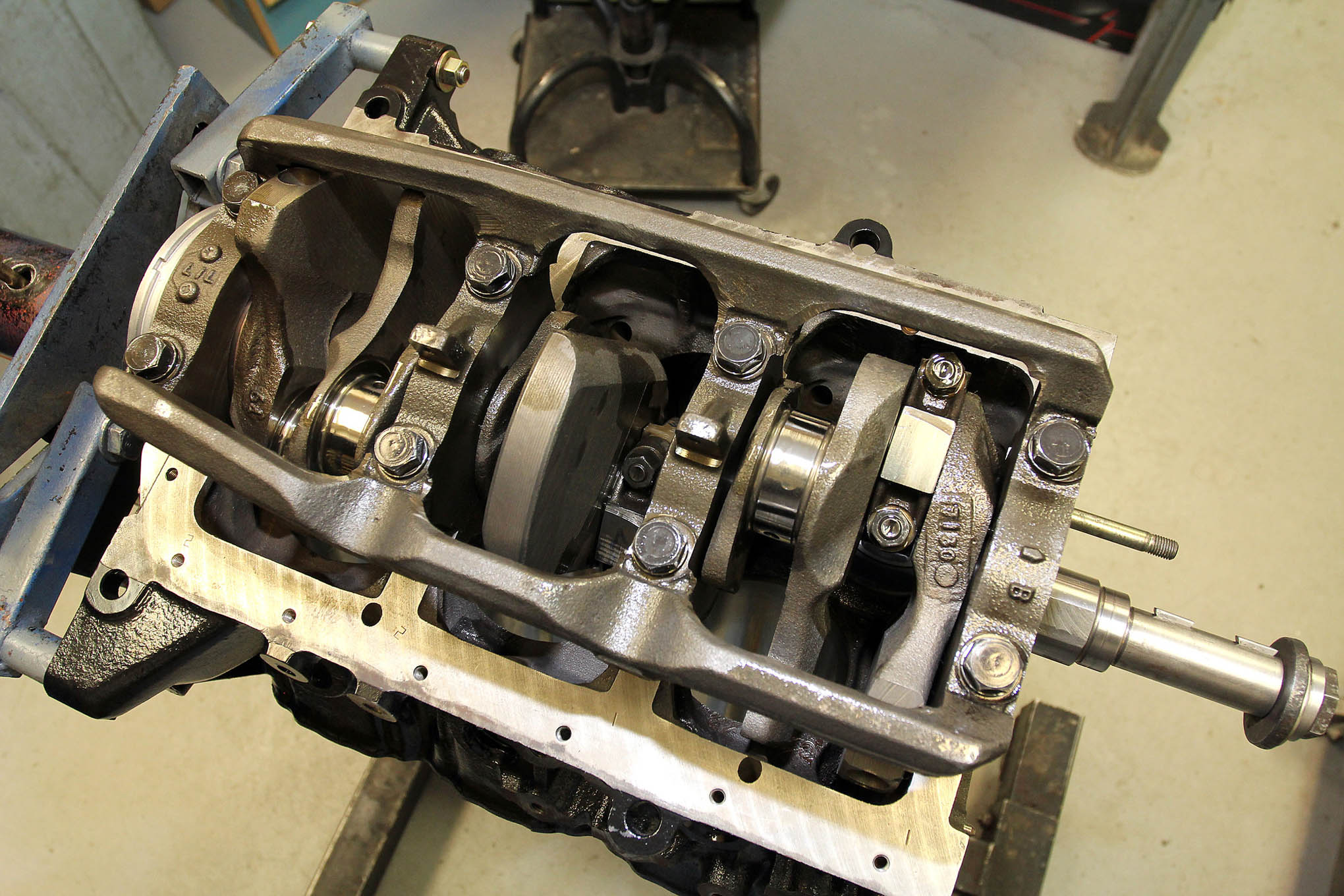 Here, the number-one rod and piston have been installed on the crank. As you can see, there's only one rod per throw.