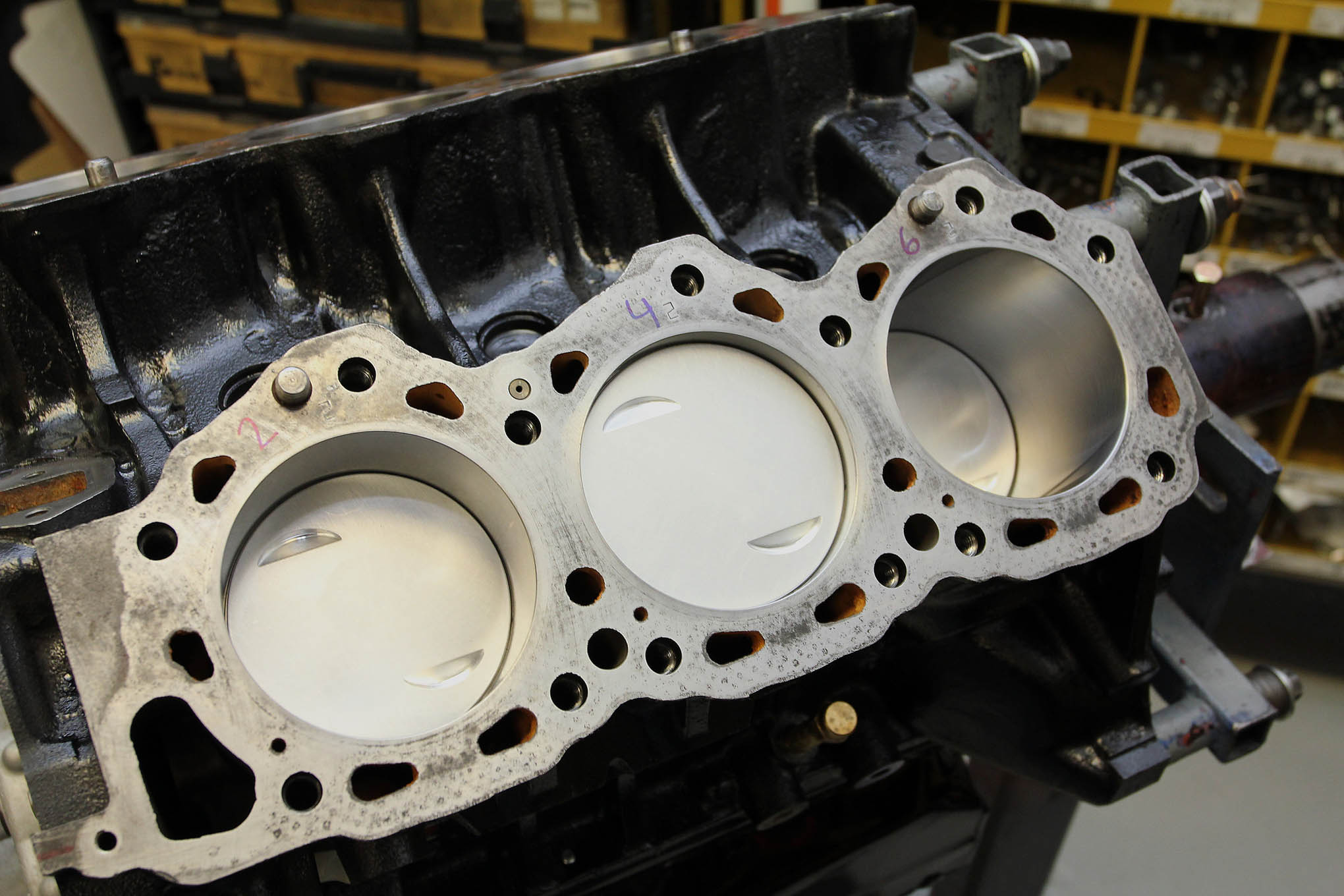 Flat-top replacement style pistons keep the compression up and costs down.