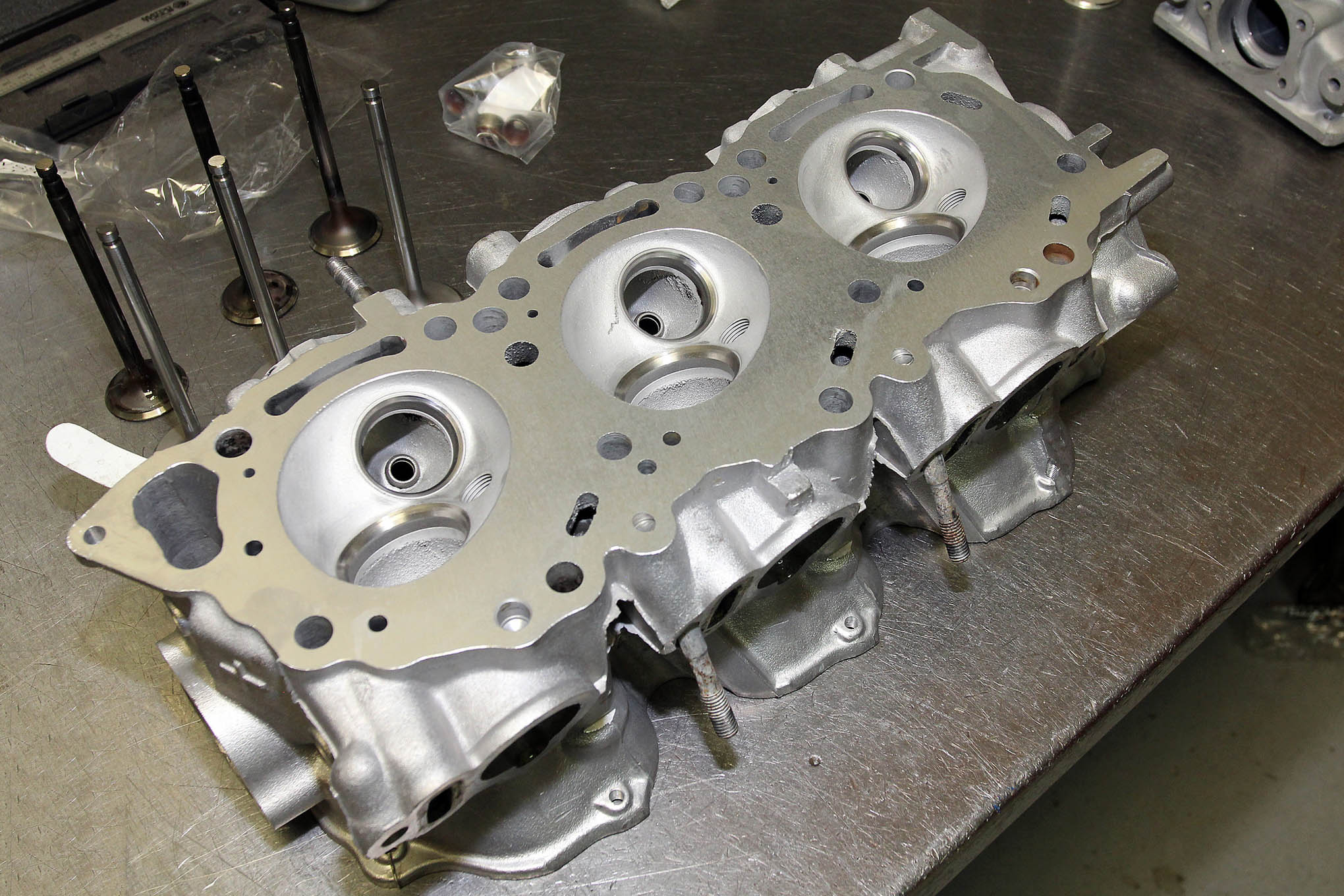 The VG30 series of engines use aluminum overhead cam cylinder heads. An upgraded three-angle valve job is allowed, and definitely recommended to help improve flow into and out of the combustion chambers. But you've got to stick with stock-size valves and any port work is strictly verboten.
