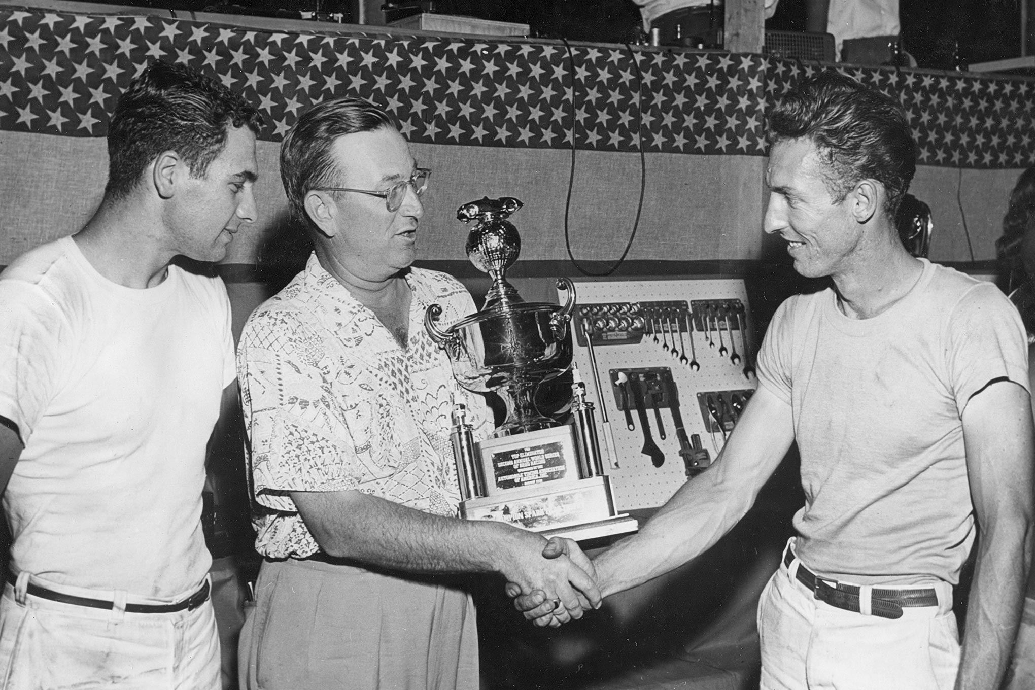 Scotty and Goldberg accepting the Top Eliminator trophy from Dick McGeorge at Lawrenceville.