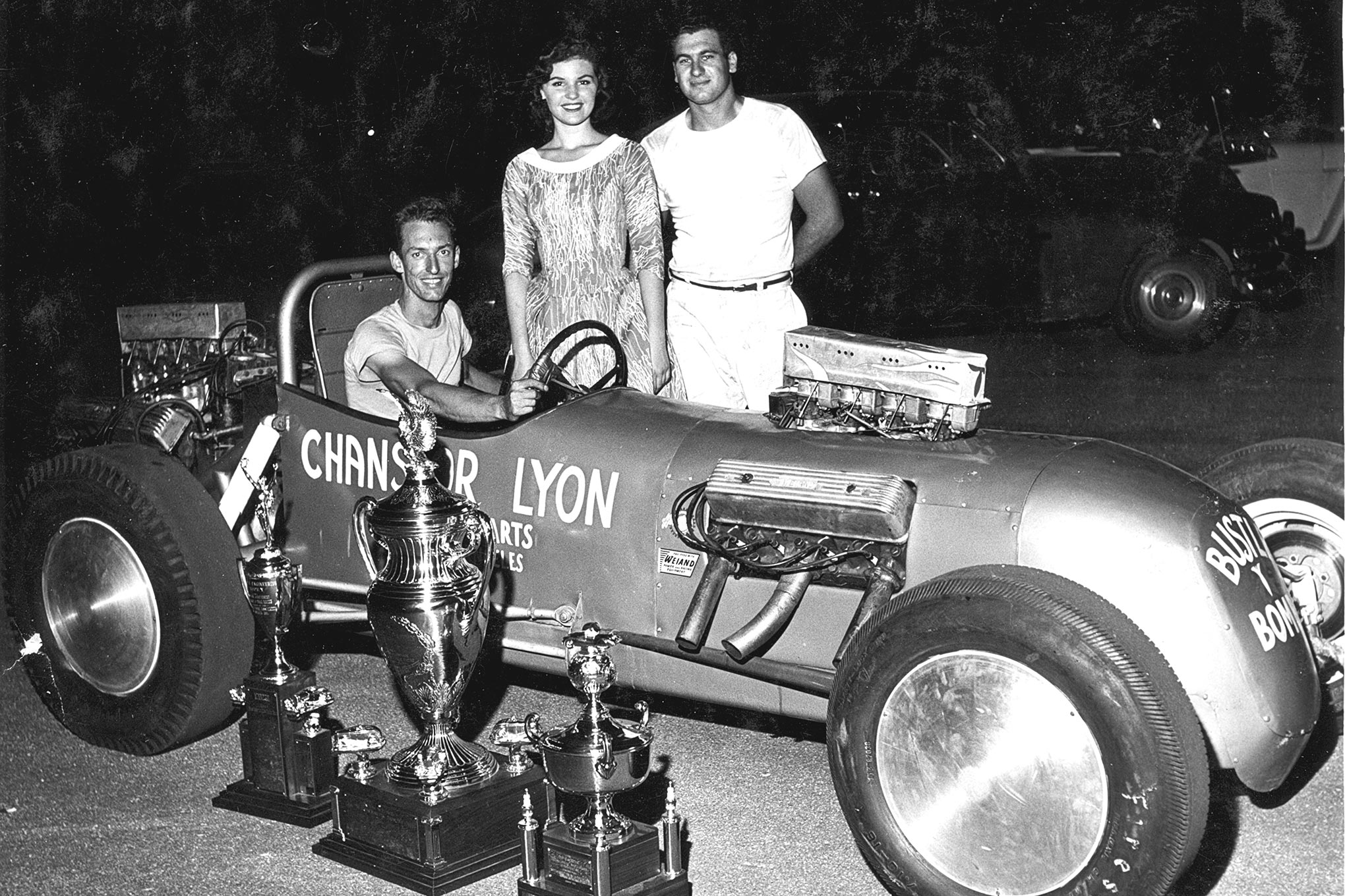 Scotty and Goldberg showing off the gold at Lawrenceville. The woman is ATAA queen Diane Daniggelis. The center trophy is the Maremont trophy for top speed. The Champion Spark Plug trophy for Top Eliminator sits to the right.