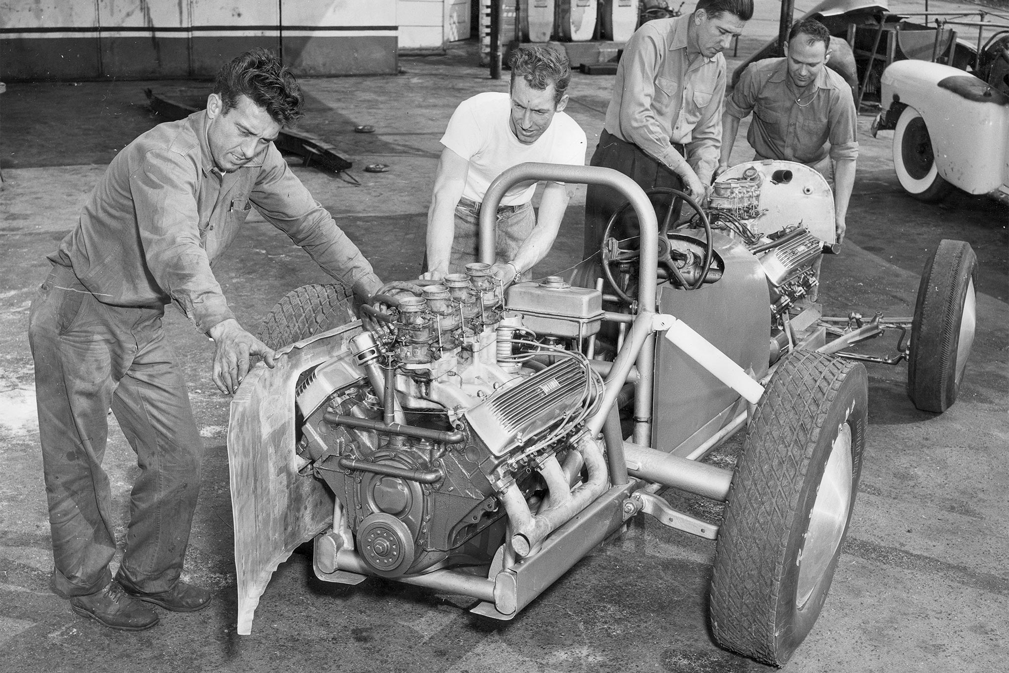 Four of the Bustle Bomb crew fabricating the rear section to fulfill sponsorship space with Howards Cams. That's George Smith, Lloyd Scott, Harold Allison, and Noel Timney.