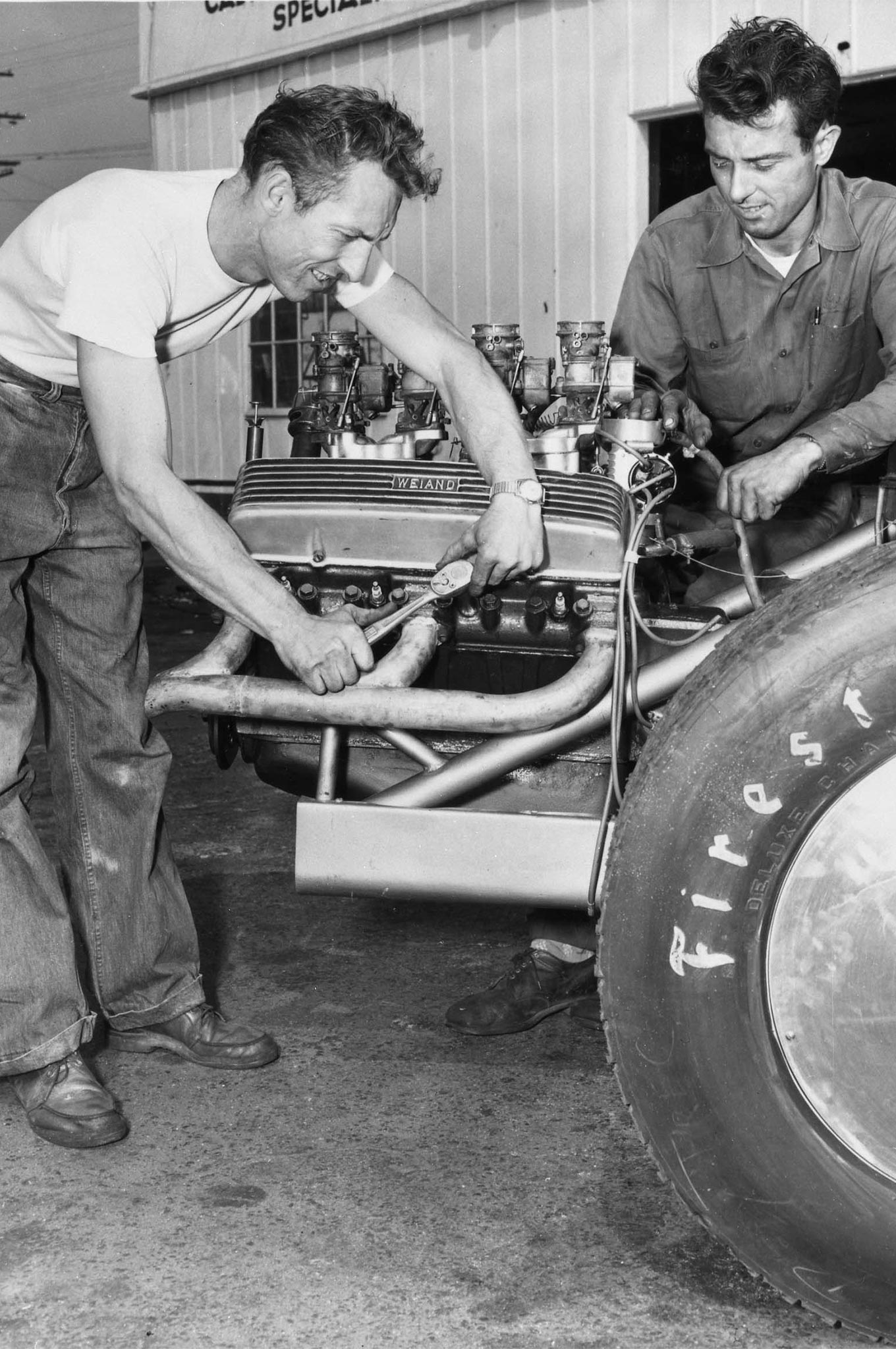 Lloyd Scott and Cadillac owner George Smith wrenching on the 391-inch stroker. This is more than likely Allison's machine shop, where they built the car, but it could be Smith's service station where they stored it.