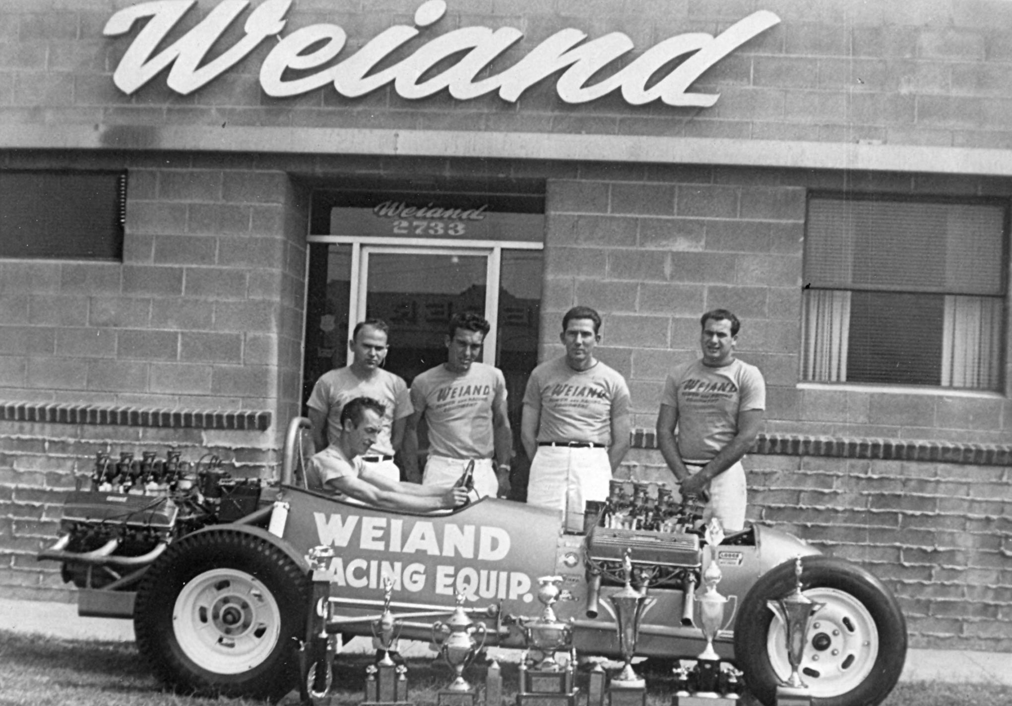 The crew at Phil Weiand's shop after securing sponsorship, October, 1955. This was one image of a series that Weiand and Howards used in joint ads in Drag News.