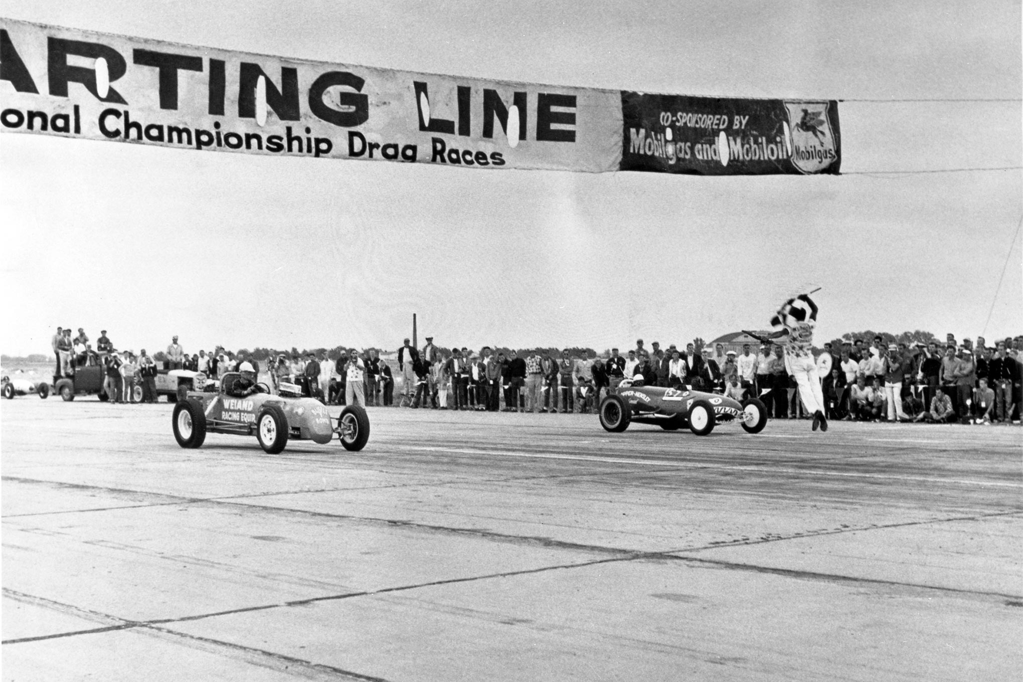Bustle Bomb squaring off against the Hopper-Hensley entry at the Inaugural NHRA National Championship in Great Bend, Kansas, late September, 1955. Rain that weekend postponed eliminations to the NHRA Southwest Regionals late November in Phoenix.