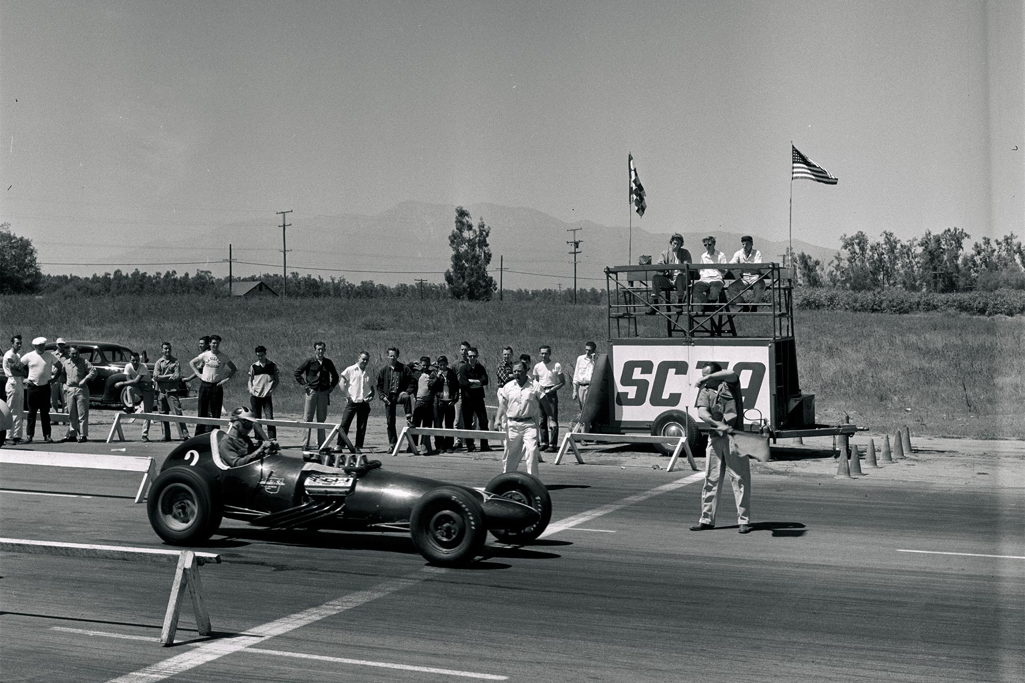 While Bustle Bomb underwent revamping in 1956, Scotty drove other cars. One was the Chrysler-powered Ed Losinski–Harry Duncan dragster shown here at Colton.