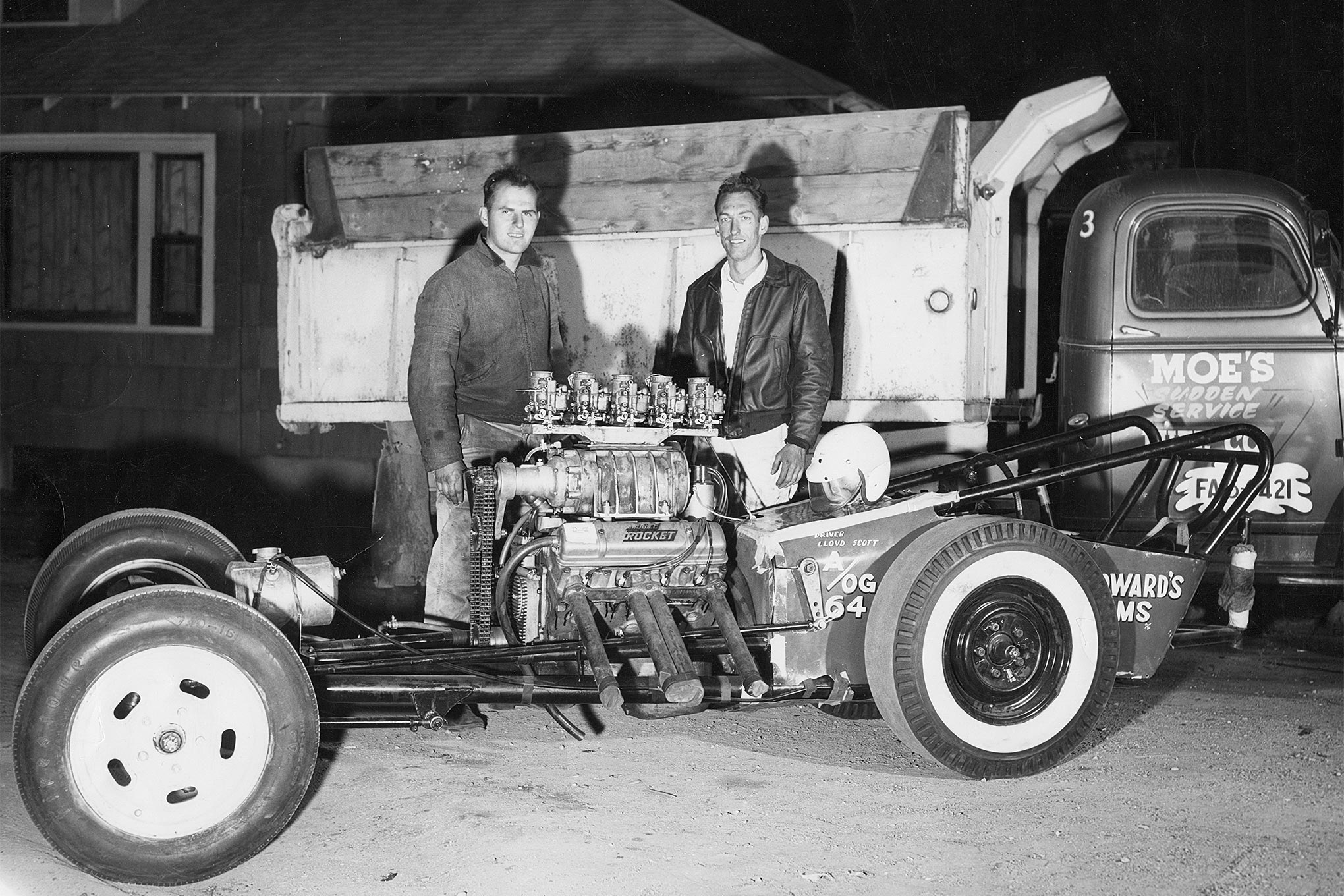 Scotty with Orville Moe after winning the 1958 Inland Empire Championships. Note the manifold for five Holley carburetors.