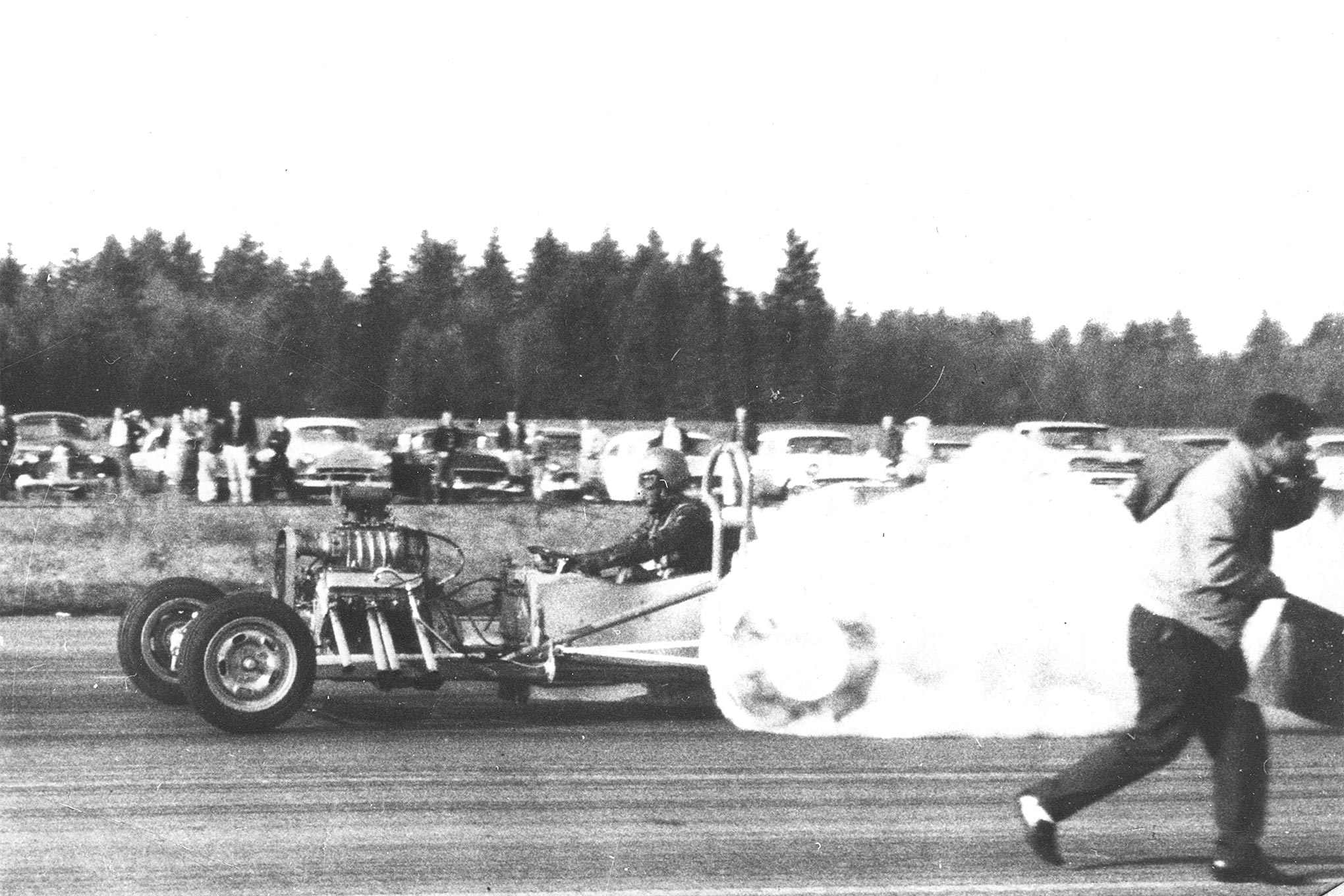 Bustle Bomb in Shelton, Washington, sometime in 1961. Note the gap between the cockpit and the front engine. Note that the front engine ran a 4-71 supercharger. Also note the higher roll hoop; like the Sleep Rocker, Bustle Bomb needed it to comply with rules.