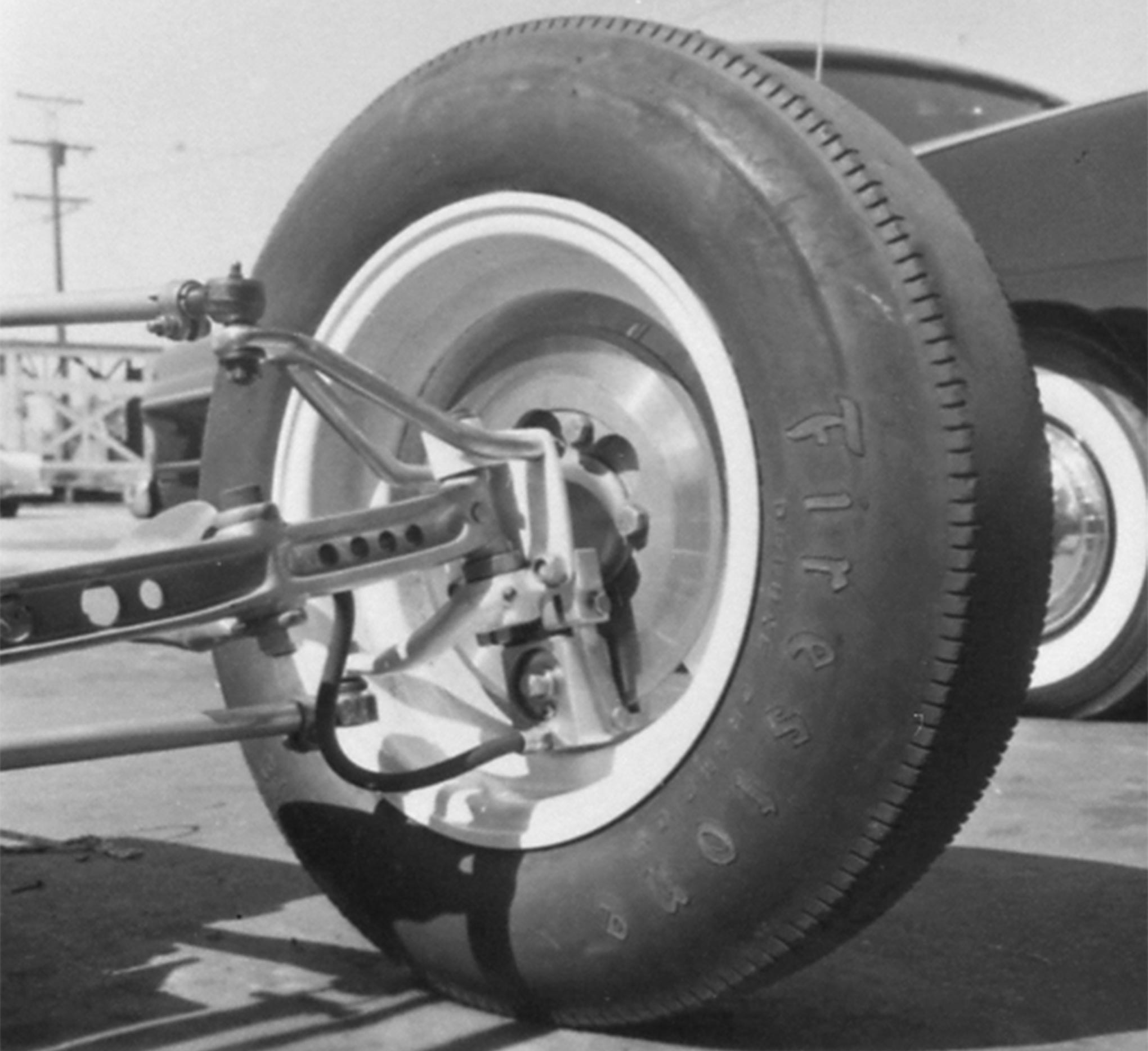 The front suspension was hot rod simple: Model A axles and split wishbone with 1942–1948 Ford spindles. The caliper is another that Timney made from scratch. The wheels and tires were IndyCar castoffs.
