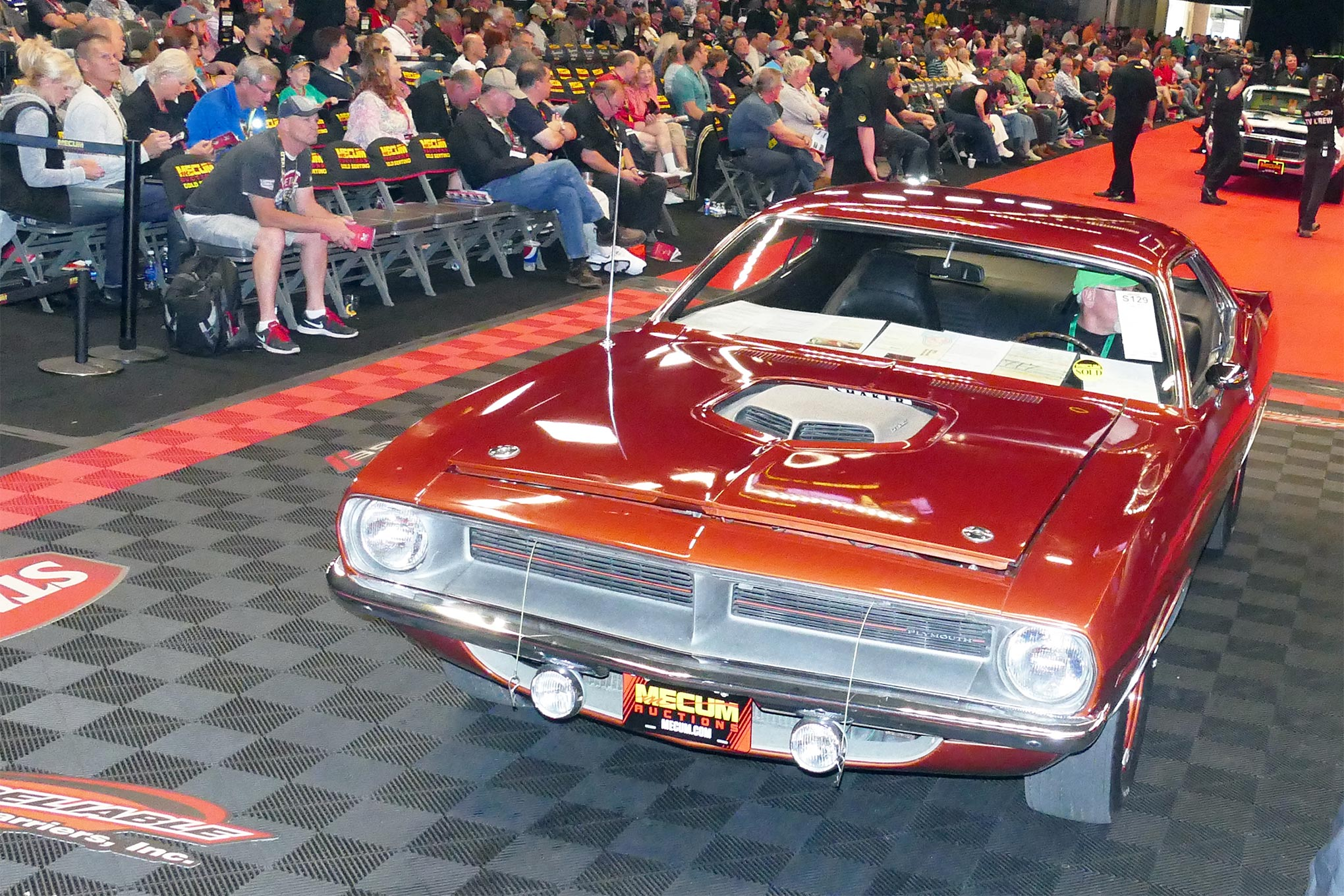 This amazing Hemi 'Cuda changed hands with a winning bid of $425,000 to highlight the sales action at Mecum's Indy Spring Classic on Saturday. With one owner until 2015, it was a special car.