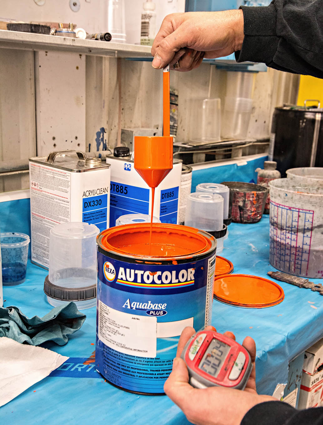 Waterborne paints are a complete system of products. While solvent-based paints are thinned about 1 to 1, waterborne is thinned more like 20 percent. Correct thinning has been achieved when the stream flowing from this special paint cup begins to break up at 22-23 seconds. The paint looks thicker than solvent types but yet requires a finer cup filter. Also in deference to Mr. Bond, waterborne paint needs to be stirred only and not shaken.