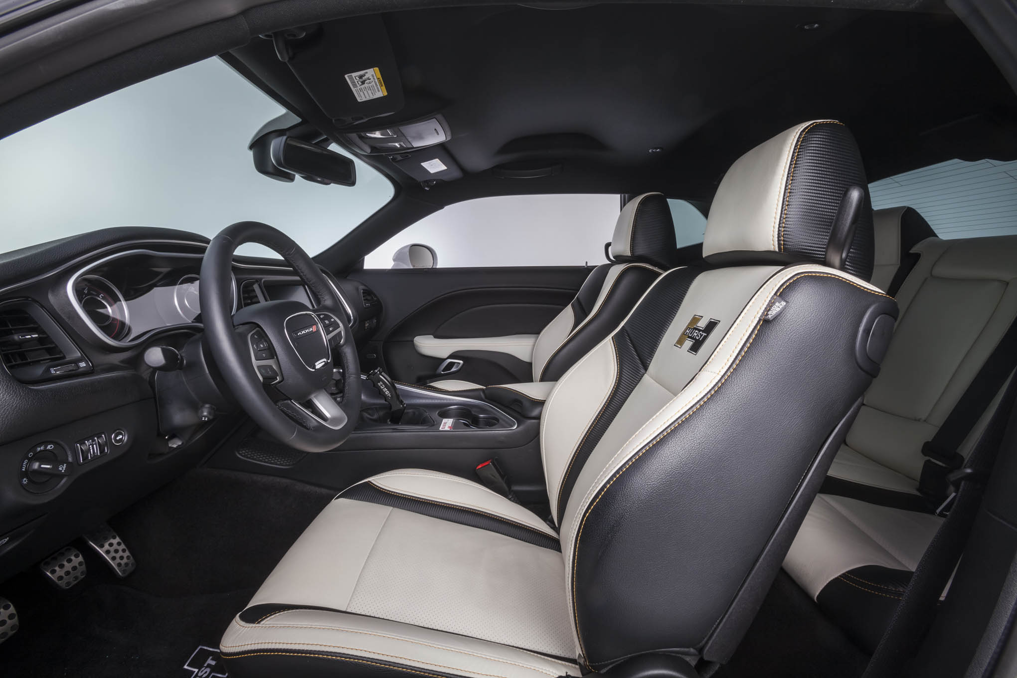 The new Challenger interior tops out as our favorite late-model muscle interior, bar none. It's the right balance of muscle and class, and the Hurst-edition leather seating in the GSS package just makes it even more inviting.