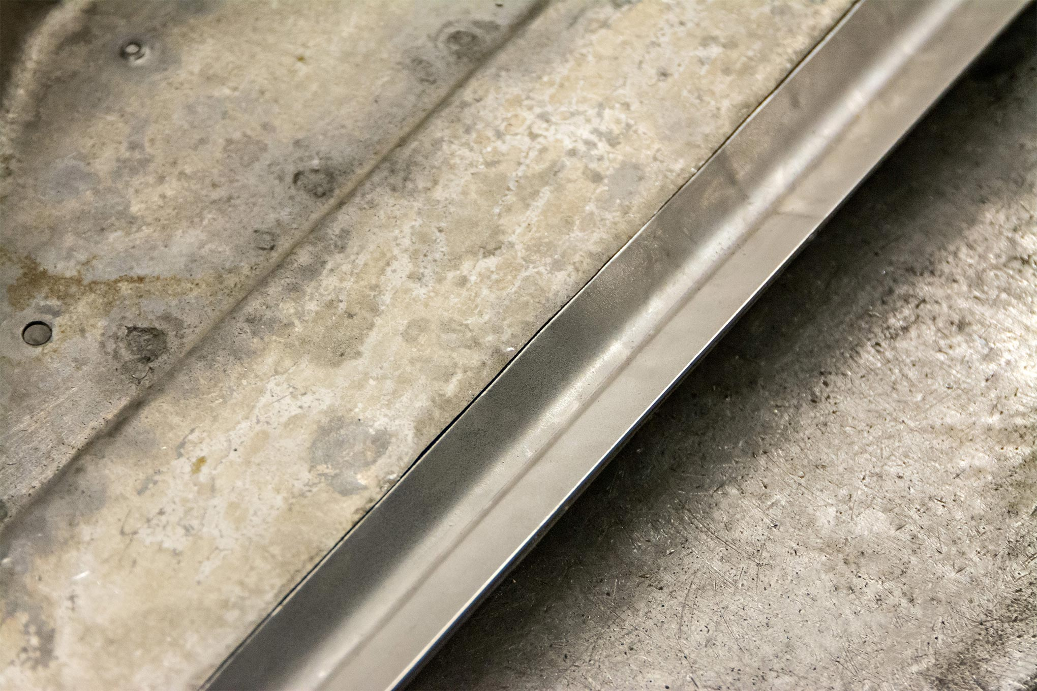 The initial test fit looks pretty good. Notice that the bend radius matches the bend in the original part. This is why it's important to bend a straight piece using a metal break. That way the radius is consistent along the entire part, even through the bend made with the shrinker.