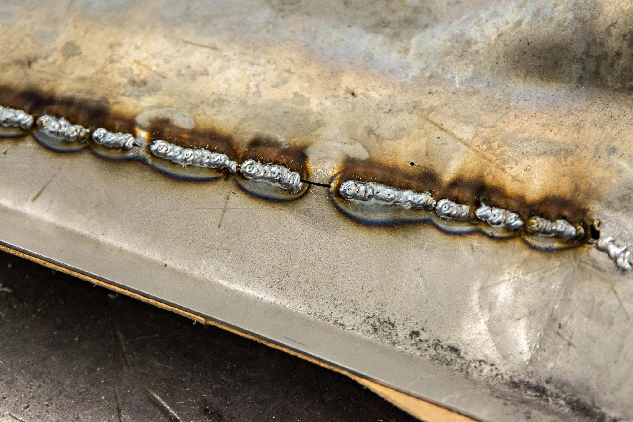 MCR never, ever runs a bead when welding body sheet metal. Instea, a series of four or five quick tack welds are used and these groupings are never right next to each other either. Spacing them apart as well allows the metal to cool before they come back to that area again.