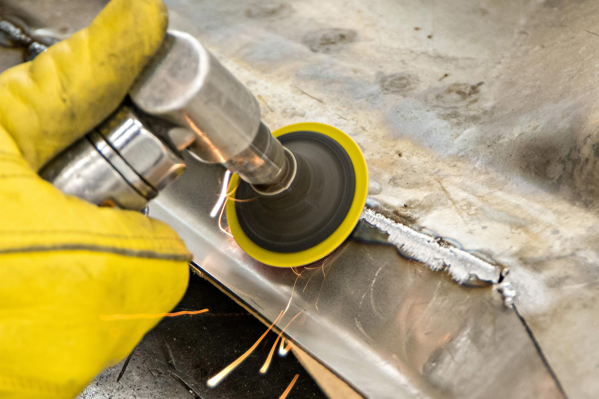 When the tack welds are all joined to together to form a solid seam, MCR uses a 36-grit disc to grind the welds flush. An 80-grit disc is then used to blend everything smooth.