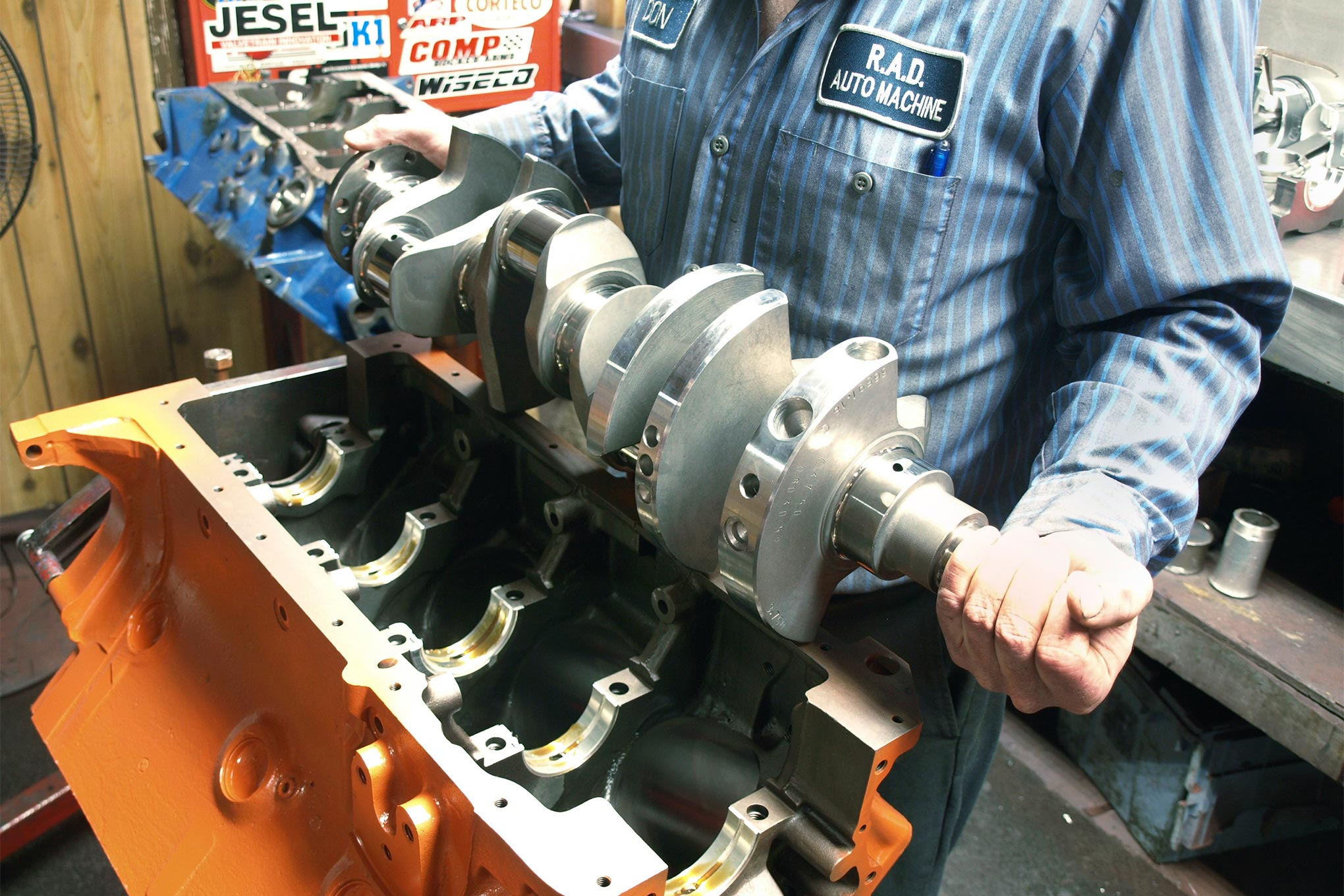 After micro-polishing and rebalancing to accommodate the lighter pistons, the 69.4-pound, forged 4340 steel crank goes into the block. The modern crank retains the eight-bolt flange and fully radiused fillets of the original Street Hemi. The bob weight is 2,598 grams.